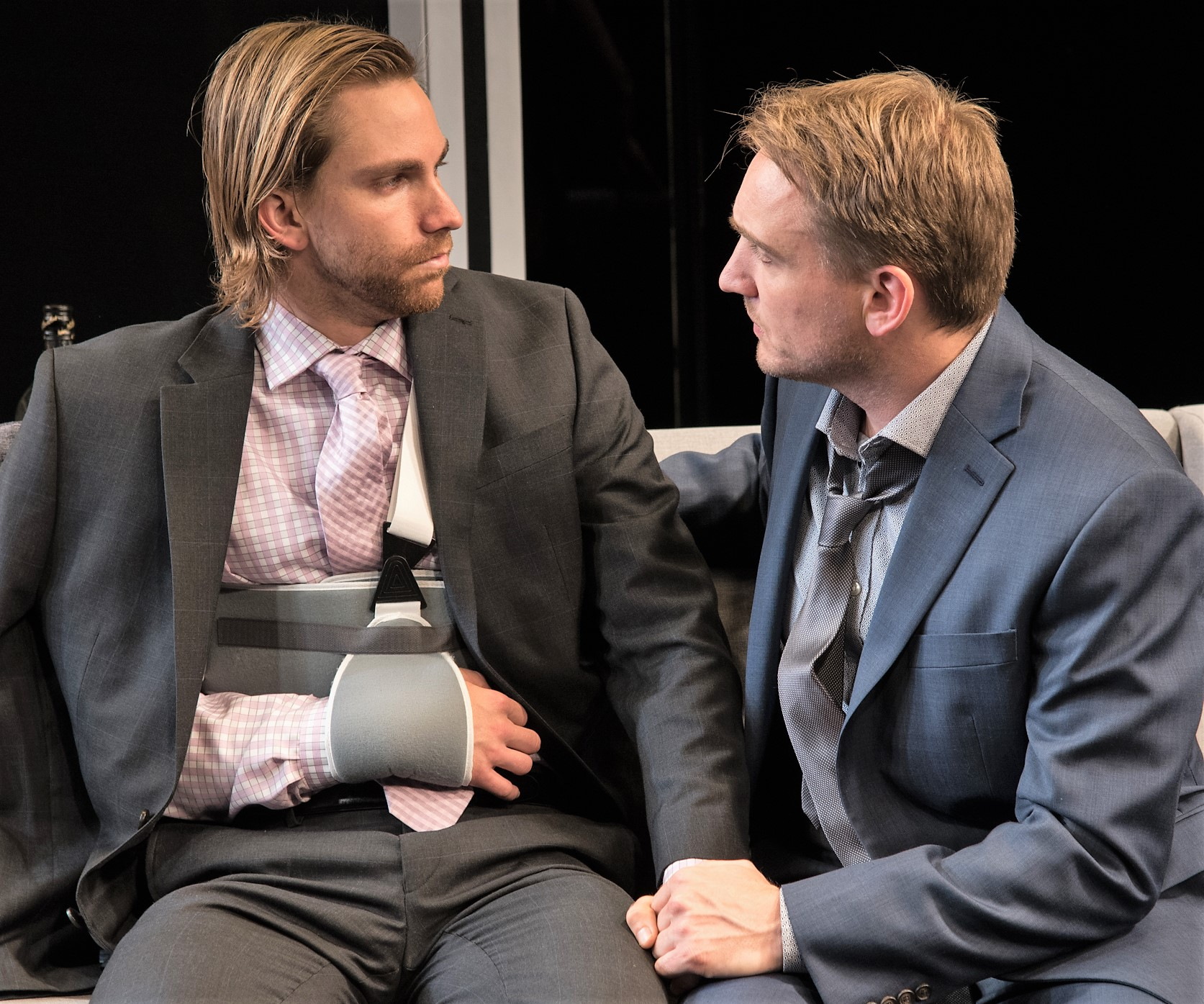 Jim Jr. and his partner Kris (Alec Shaw, left) share a moment.