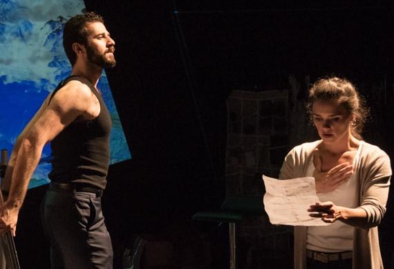 Roger (Michael Romeo Ruocco), Julie's boyfriend, listens as Julie's daughter Jill (Santina Umbach) reads a poem.