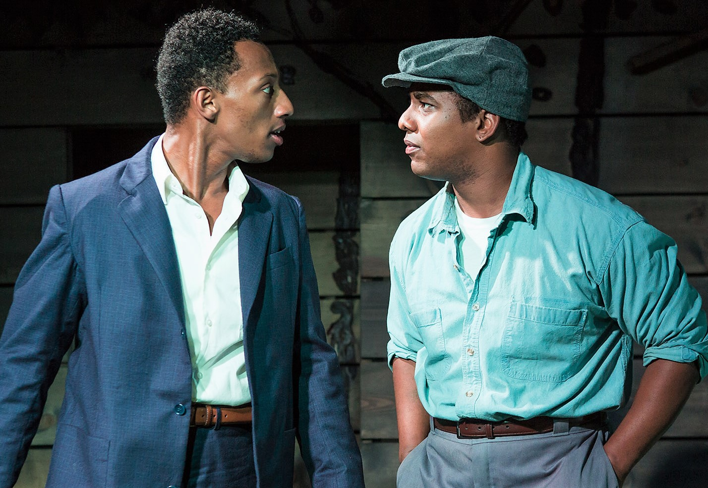 Brandon Gill as Bowzie, politicized in his first months of college, and Hampton Fluker as Tony in  Too Heavy for Your Pocket . Above: Fluker with Nneka Okafor (left) as Sallie-Mae. Photos by Jeremy Daniel.