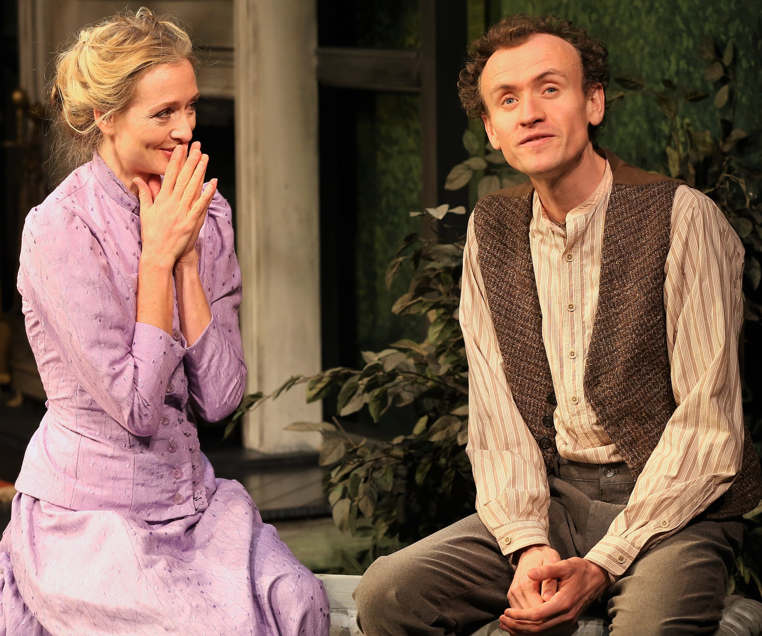 Rachel Pickup (left) is the upwardly mobile Margaret, and Ed Malone is her aspiring suitor David, in Brian Friel's  The Home Place . Top: Pickup with John Windsor-Cunningham as Christopher Gore.