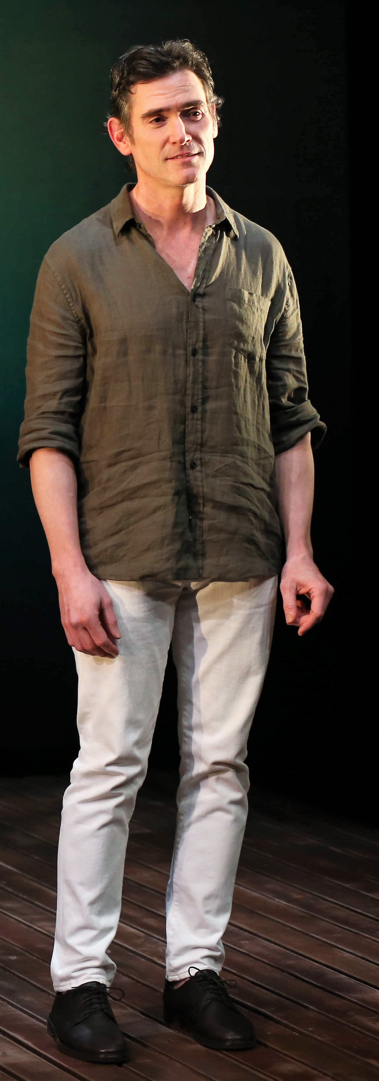 Billy Crudup (above and at top) plays a con man reminiscent of Tom Ripley in David Cale's solo show  Harry Clarke . Photographs by Carol Rosegg.