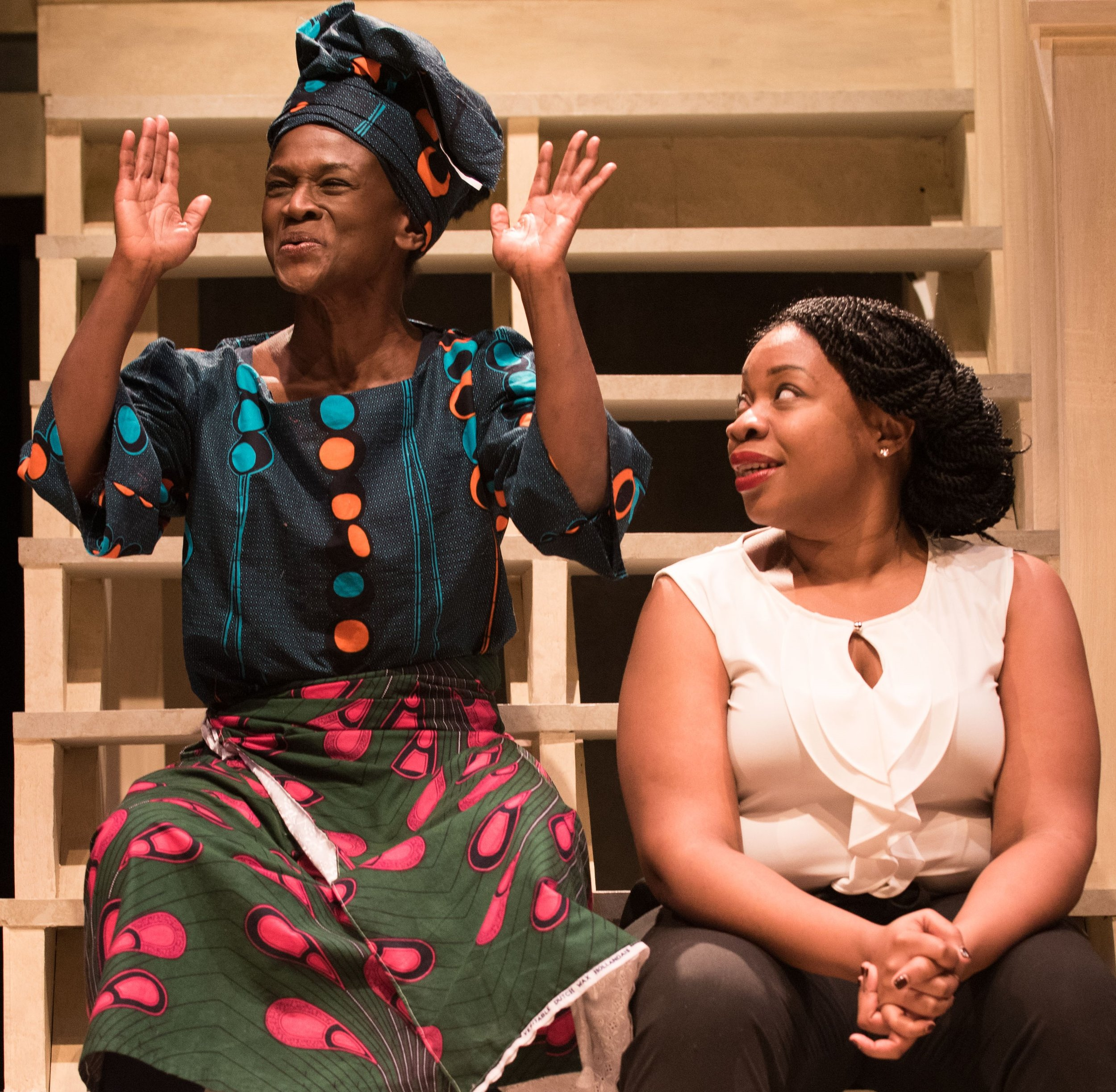 Udofia (right) with Patrice Johnson as one of the village women.