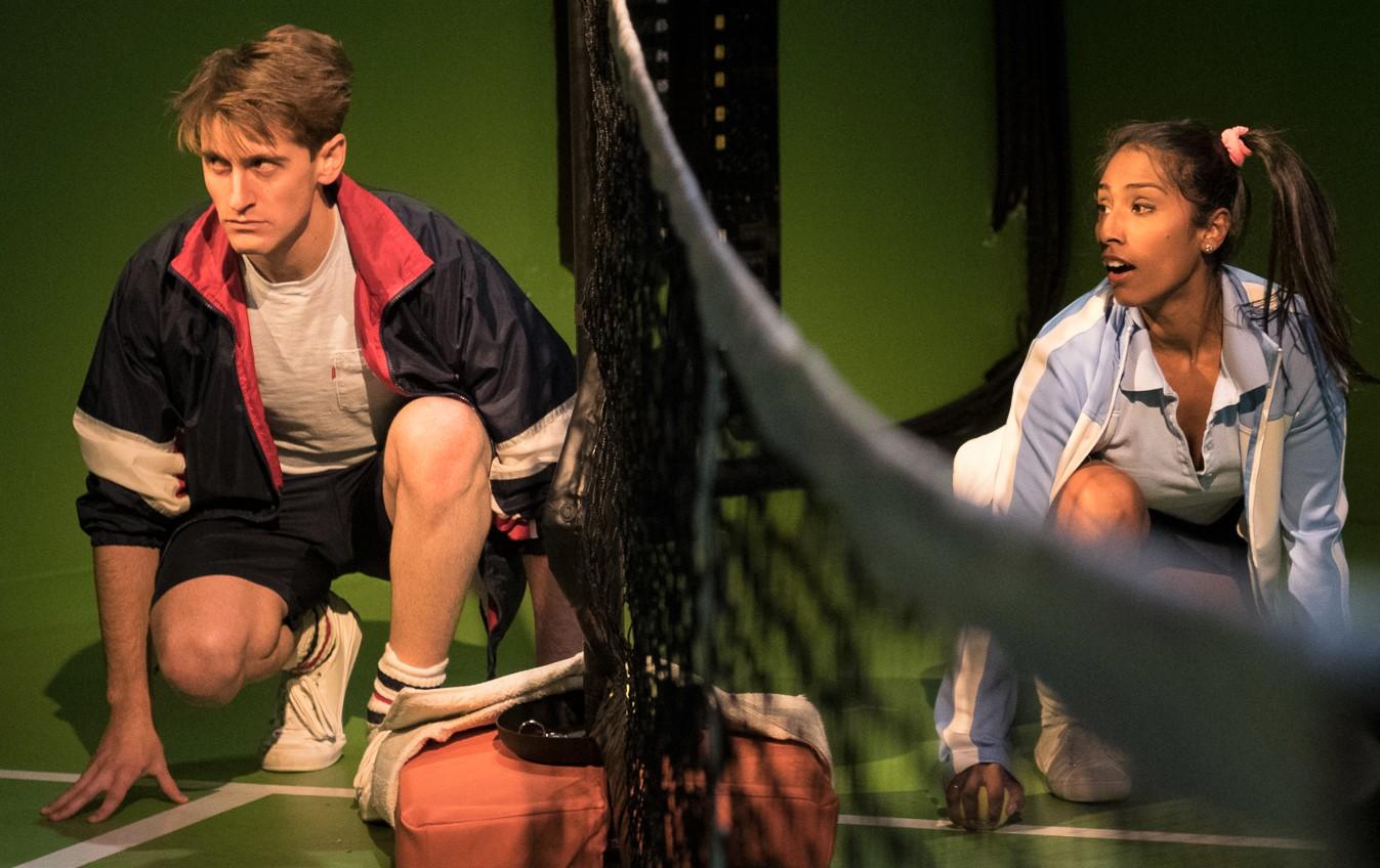 Alex J. Gould as the Ballboy and Elisha Mudly as the Ballgirl in  Balls . Top: Ellen Tamaki as Billie and Donald Corren as Bobby.