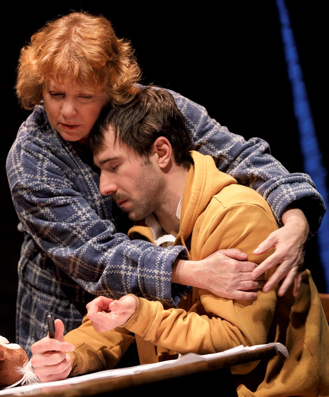 Nancy (Becky Ann Baker) comforts her son, Nat (Alex Hurt). Photographs by Joan Marcus.