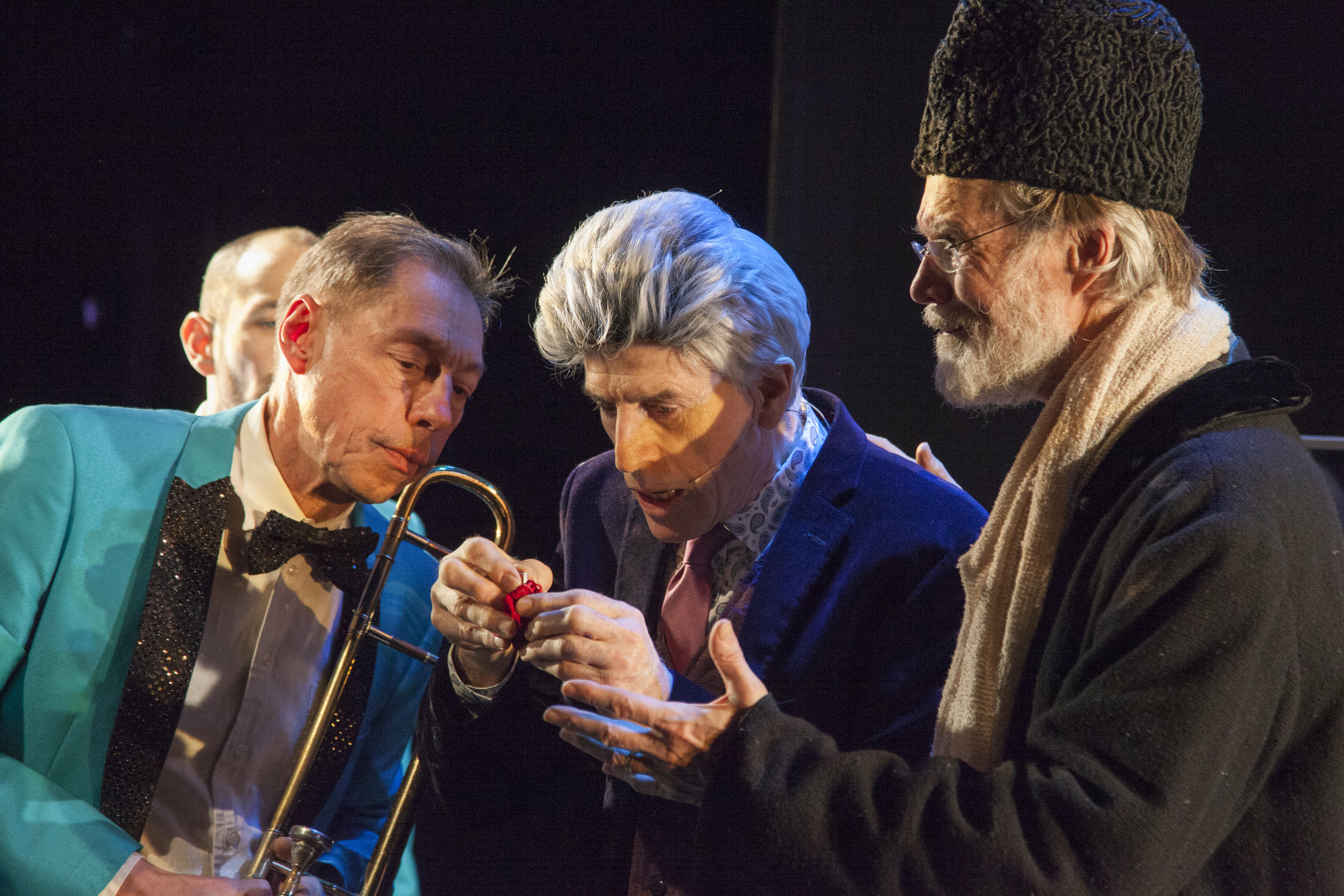 """Decker and Grey with Peter Zummo (left, holding a trombone) examine a clue given by their favorite friend, """"Anne Green."""" Photographs by Suzanne Opton."""