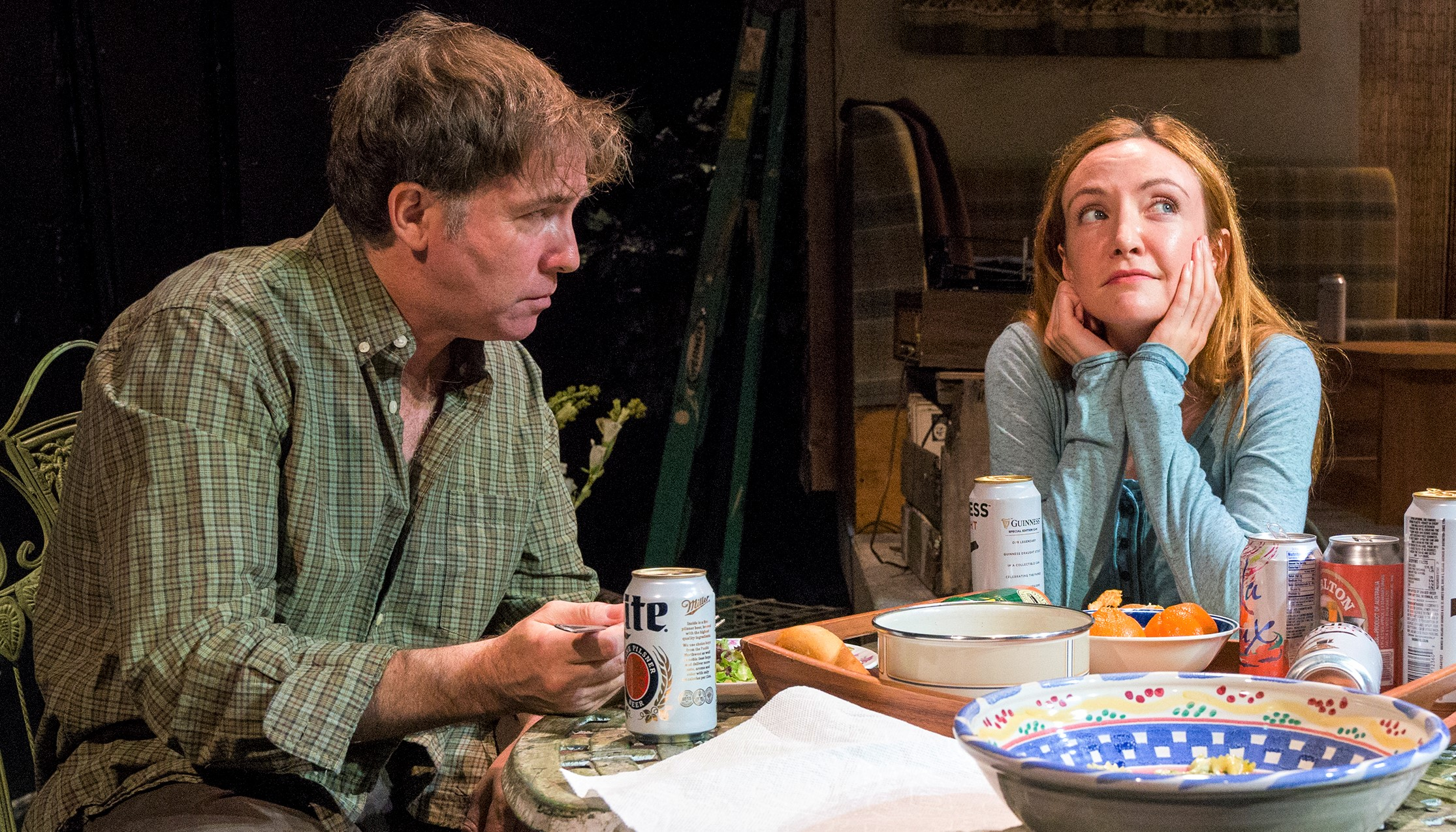 Tim Ruddy as Billy Sloane and Sarah Street as Josie Larmer dine alfresco in Jaki McCarrick's  The Naturalists . Top: Street and Ruddy with John Keating as Billy's brother Francis in the play's final scene. Photographs by Richard Termine.