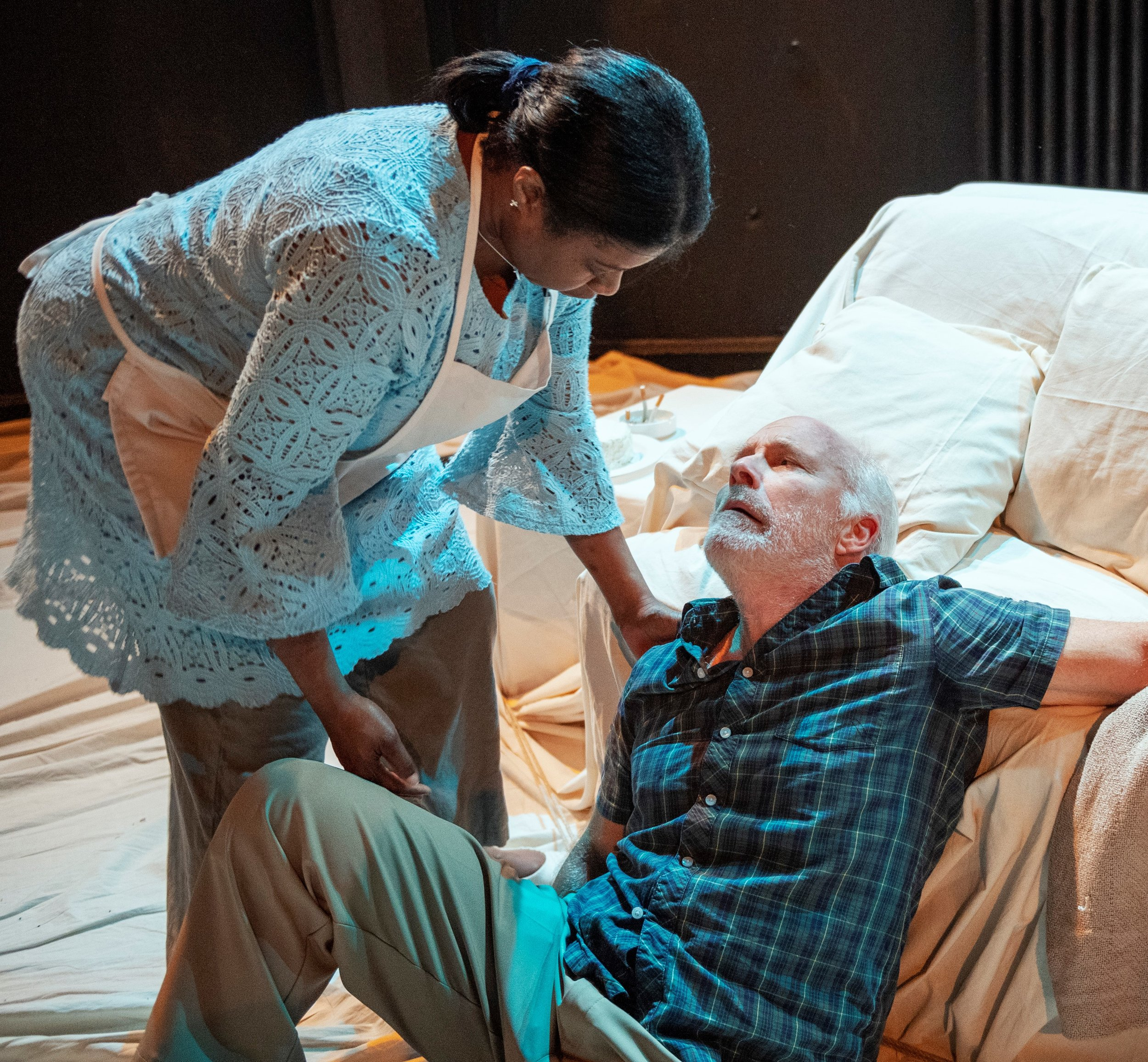Janet (Abrams) nurses a stricken Bob (Butler). Photographs by Deen van Meer.