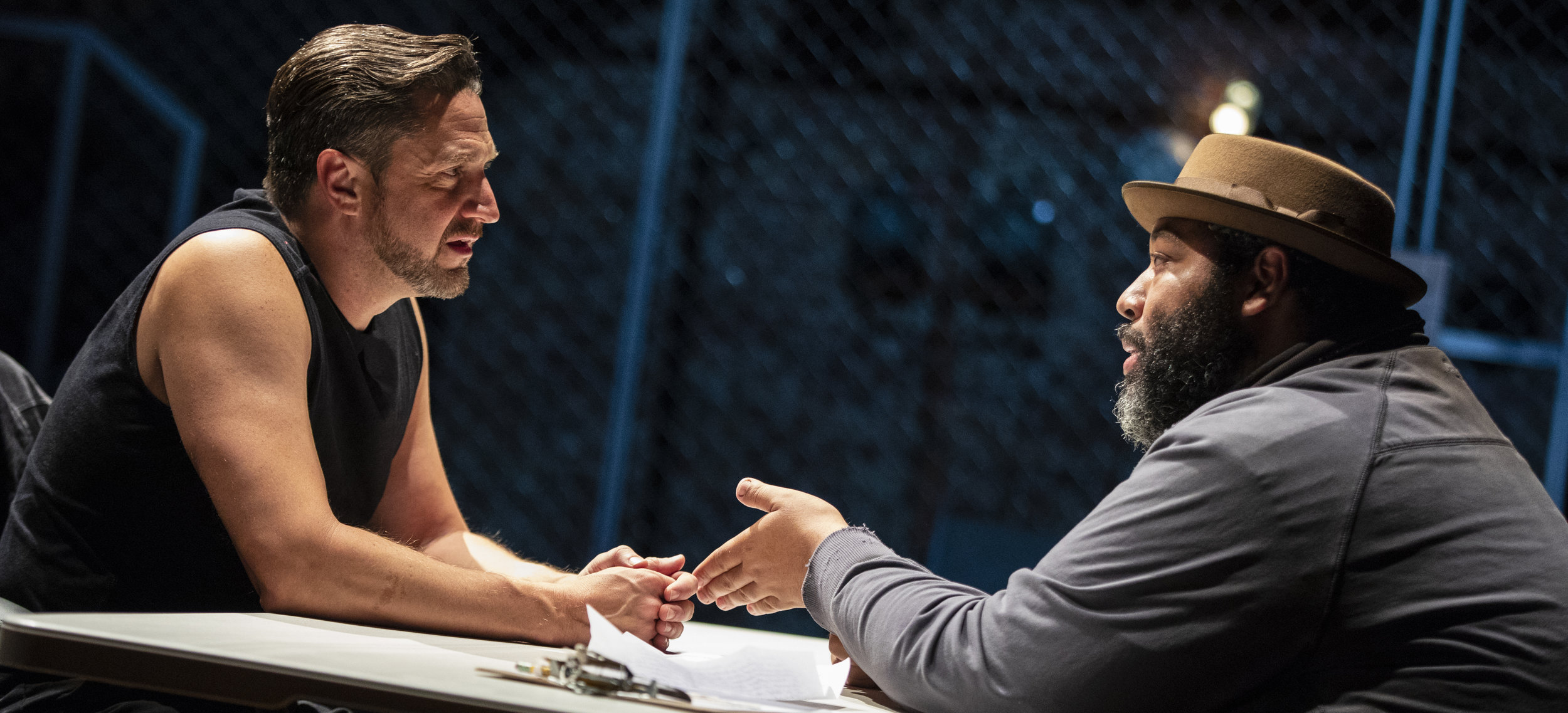 Raúl Esparza (left) plays the title role and Eddie Cooper is Ernie Roma in Bertolt Brecht's  The Resistible Rise of Arturo Ui.  Top: A scene from the play, with George Abud (center).
