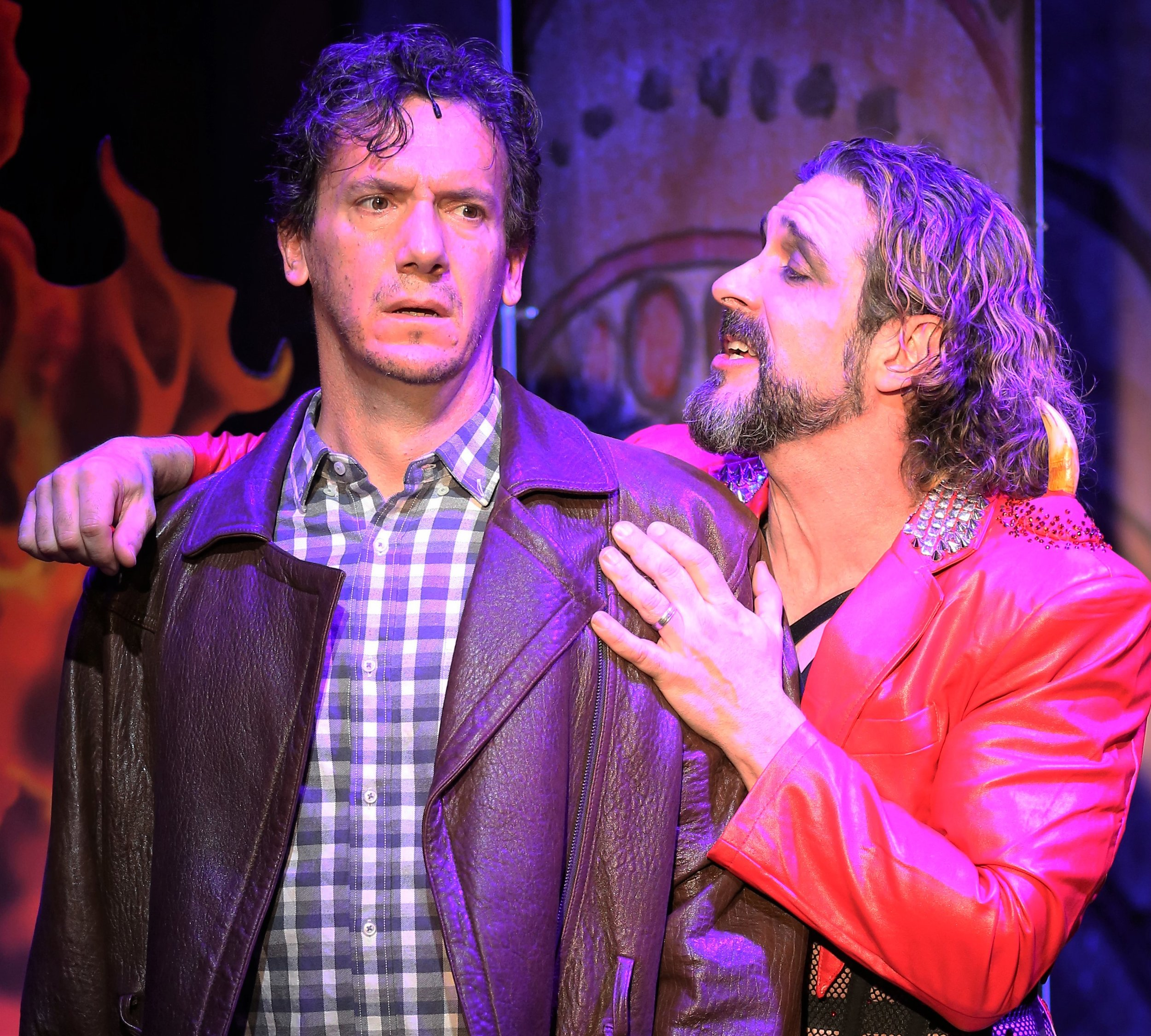 Richard (Scott Ahearn) in the hands of Lucifer (Brandon Williams) in Gary Apple's  Christmas in Hell . Top: Galiana (Lori Hammel) and Carl (Zak Risinger) debate entering the gates of Hades. Photographs by Carol Rosegg.