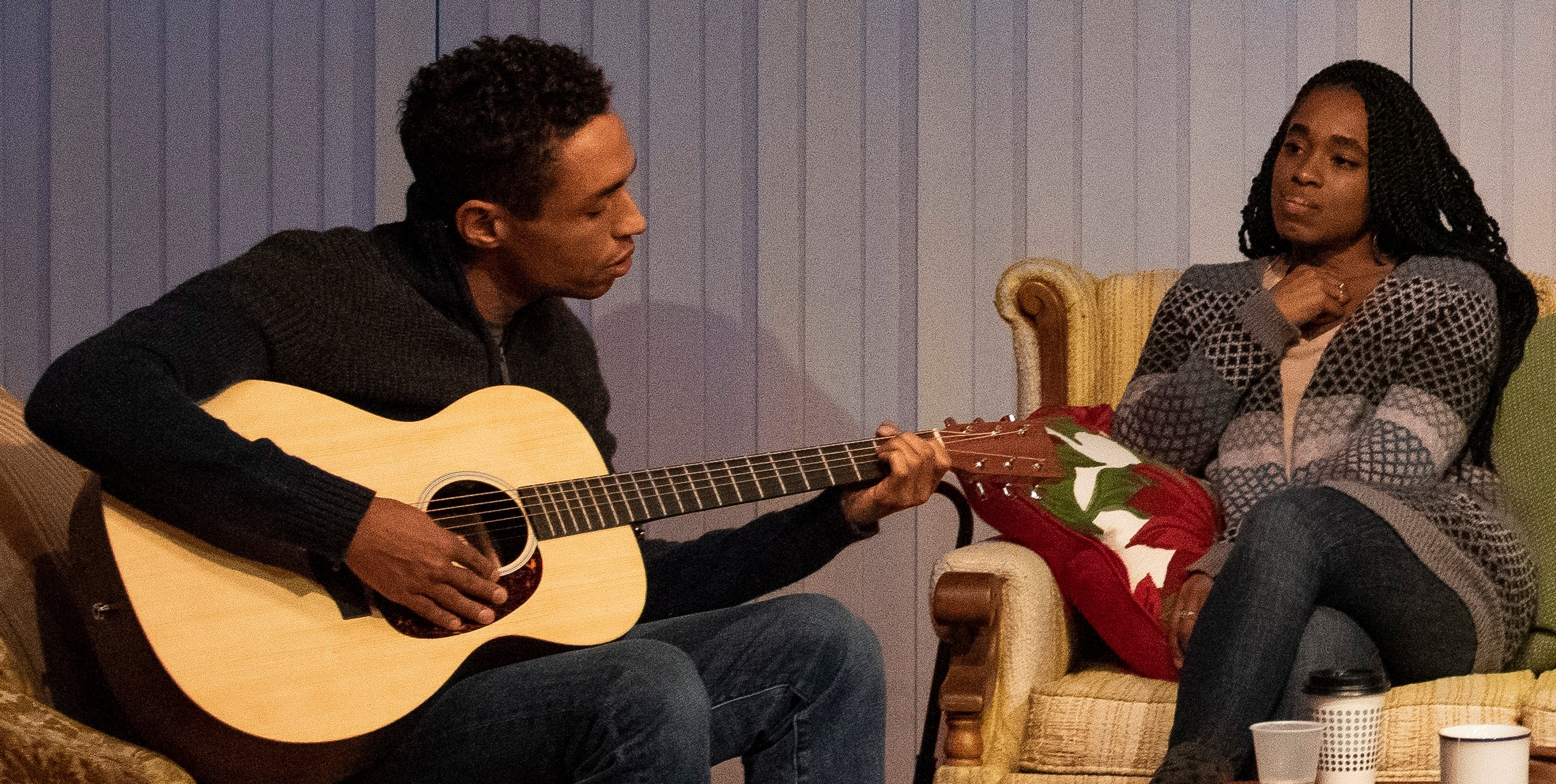Wade (Kyle Beltran), plays for Cherie (Lloyd). Photographs by Ahron R. Foster.