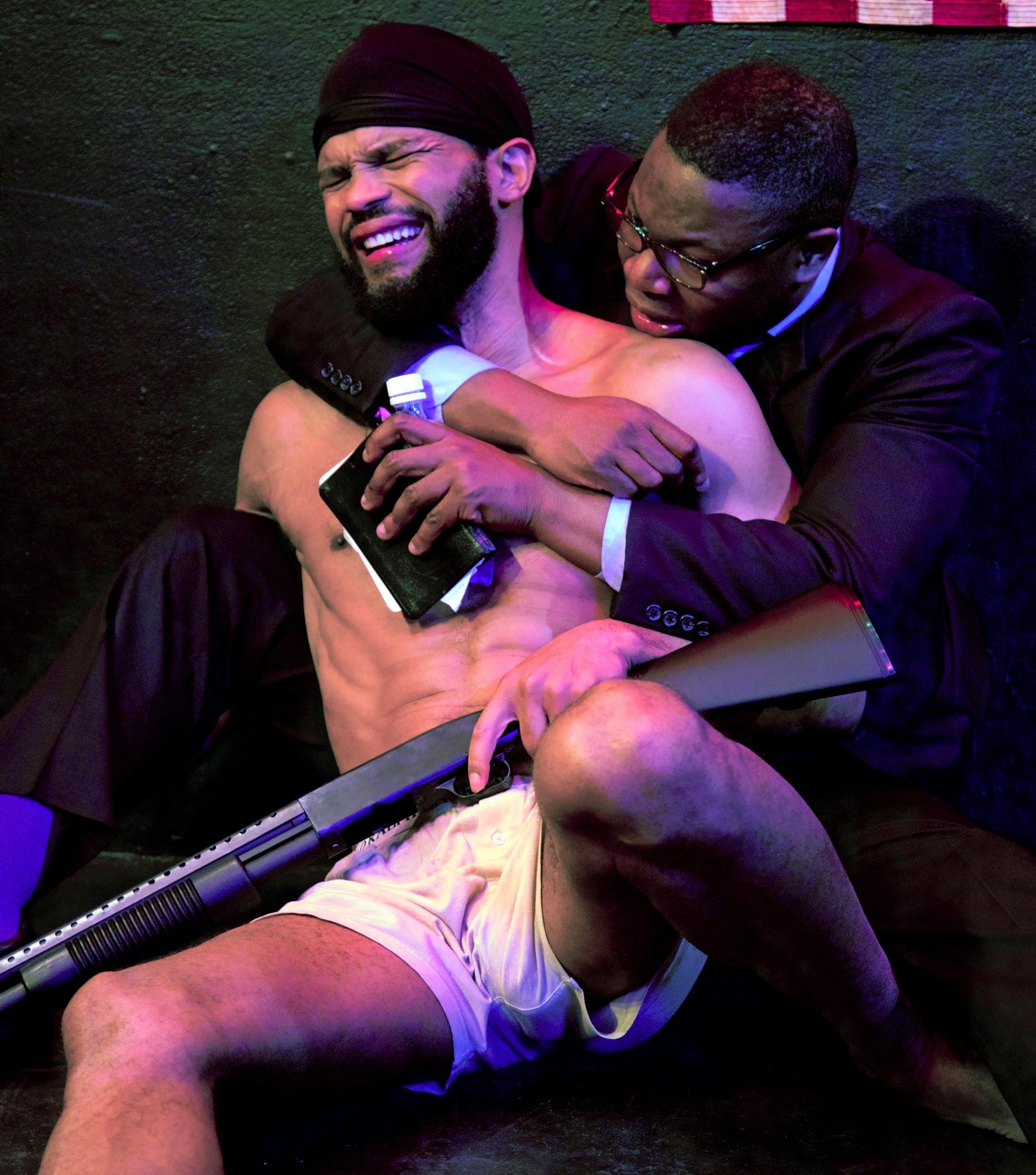 Jim-Bo (Abili) holding his brother Cornbread (Cesar). Photographs by David Zayas Jr.
