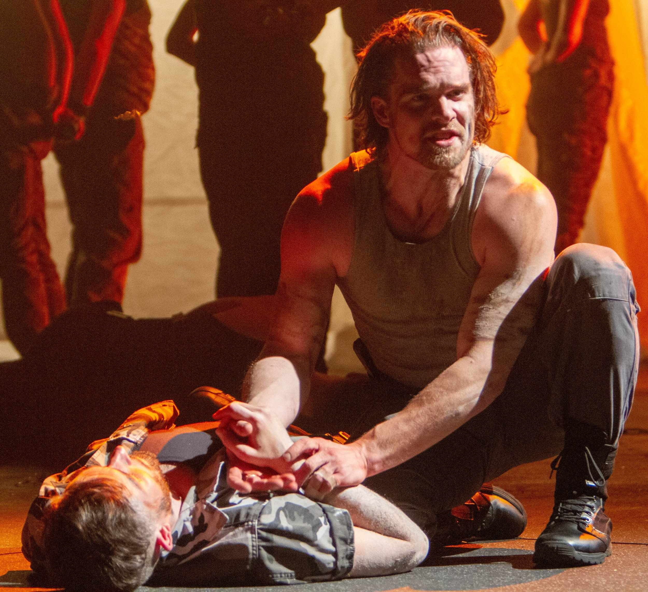 Caska (Stephen Michael Spencer) kneels over Cassius's corpse. Photographs by Henry Grossman.