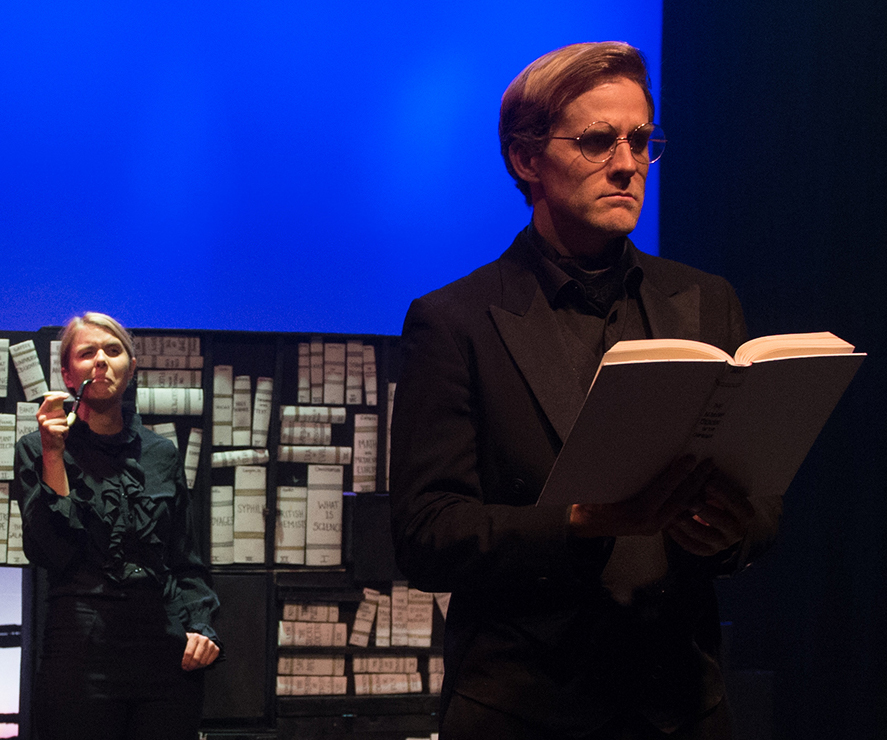 Dr. Jekyll (Burt Grinstead) visits the library of Dr. Lanyon (Anna Stromberg) in the Blanket Fort production of  Dr. Jekyll & Mr. Hyde.  Top: A police officer (Stromberg) has questions for Jekyll (Grinstead).