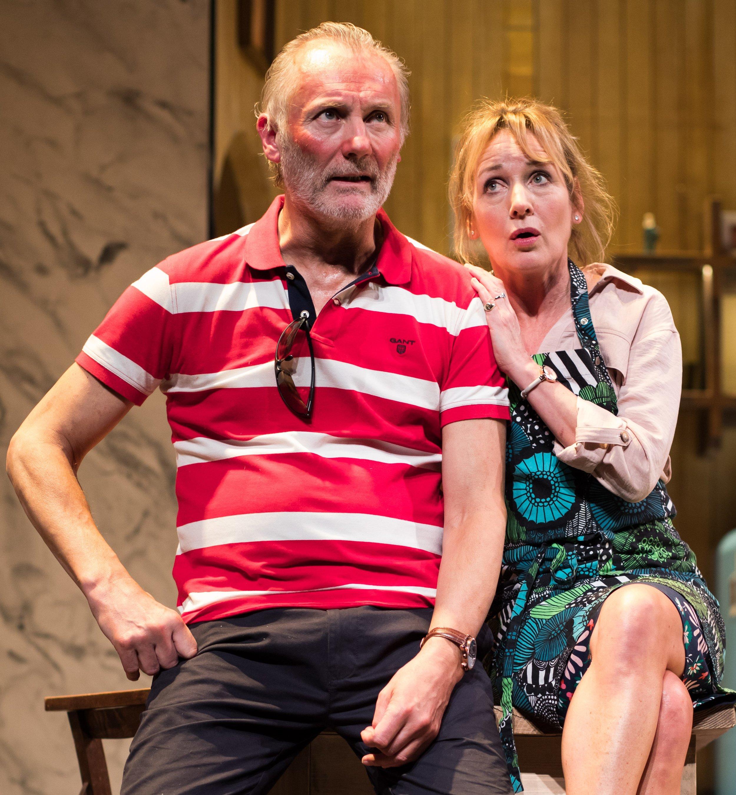 Caroline (Caroline Langrishe) comforts husband Mike (Aden Gillett) in Caroline's Kitchen. Top: Langrishe with assistant Amanda (Jasmyn Banks).