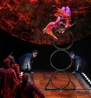 Acrobats dressed in bird costumes jump through stacked hoops at Cirque du Soleil's tribute to Mexico, Luzia. Top: Aerialist Benjamin Courtenay performs on a rope in an imagined cenote, with a jaguar nearby.
