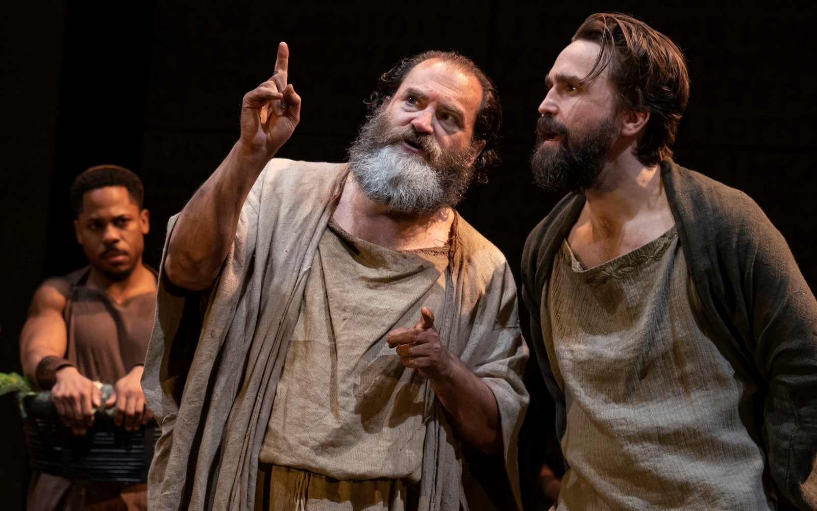 Michael Stuhlbarg (center) is Socrates and Joe Tapper (right) is Agathon, with Ro Boddie (left) looking on, in Tim Blake Nelson's Socrates. Top: Stuhlbarg with Robert Joy.