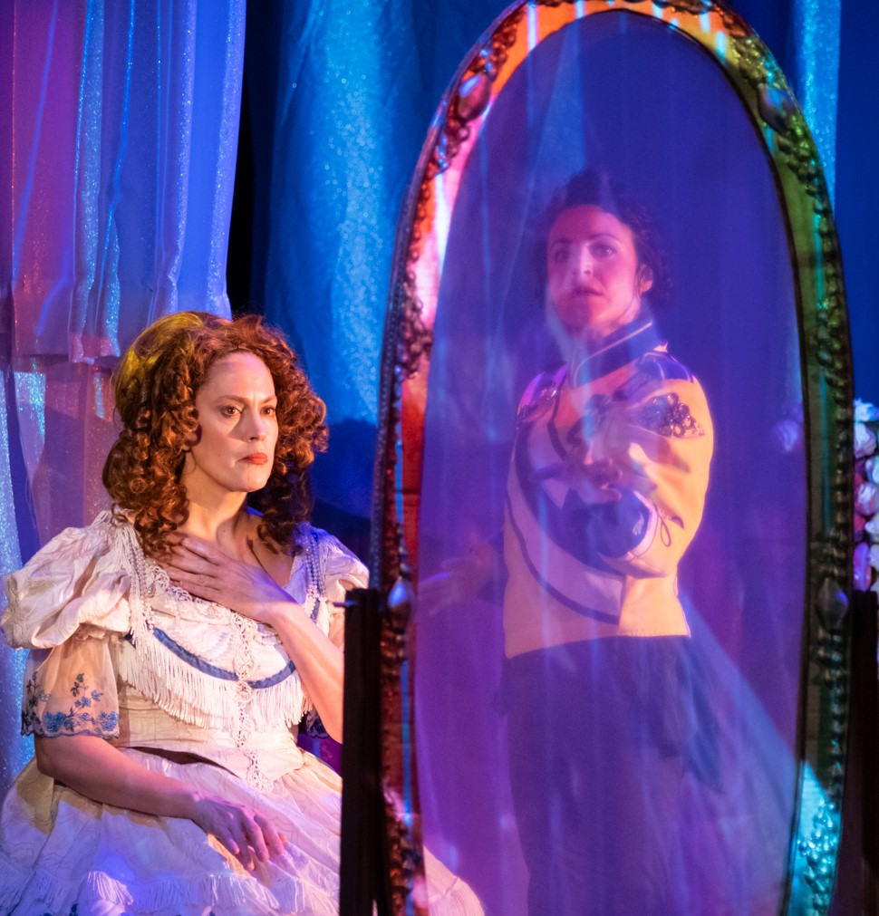"Kelly as Madame Lynch in a contemplative moment and Lisa Clari (right), who is a singer and waltzer in the ""spectacle with music and dance."" Photographs by Russ Rowland."