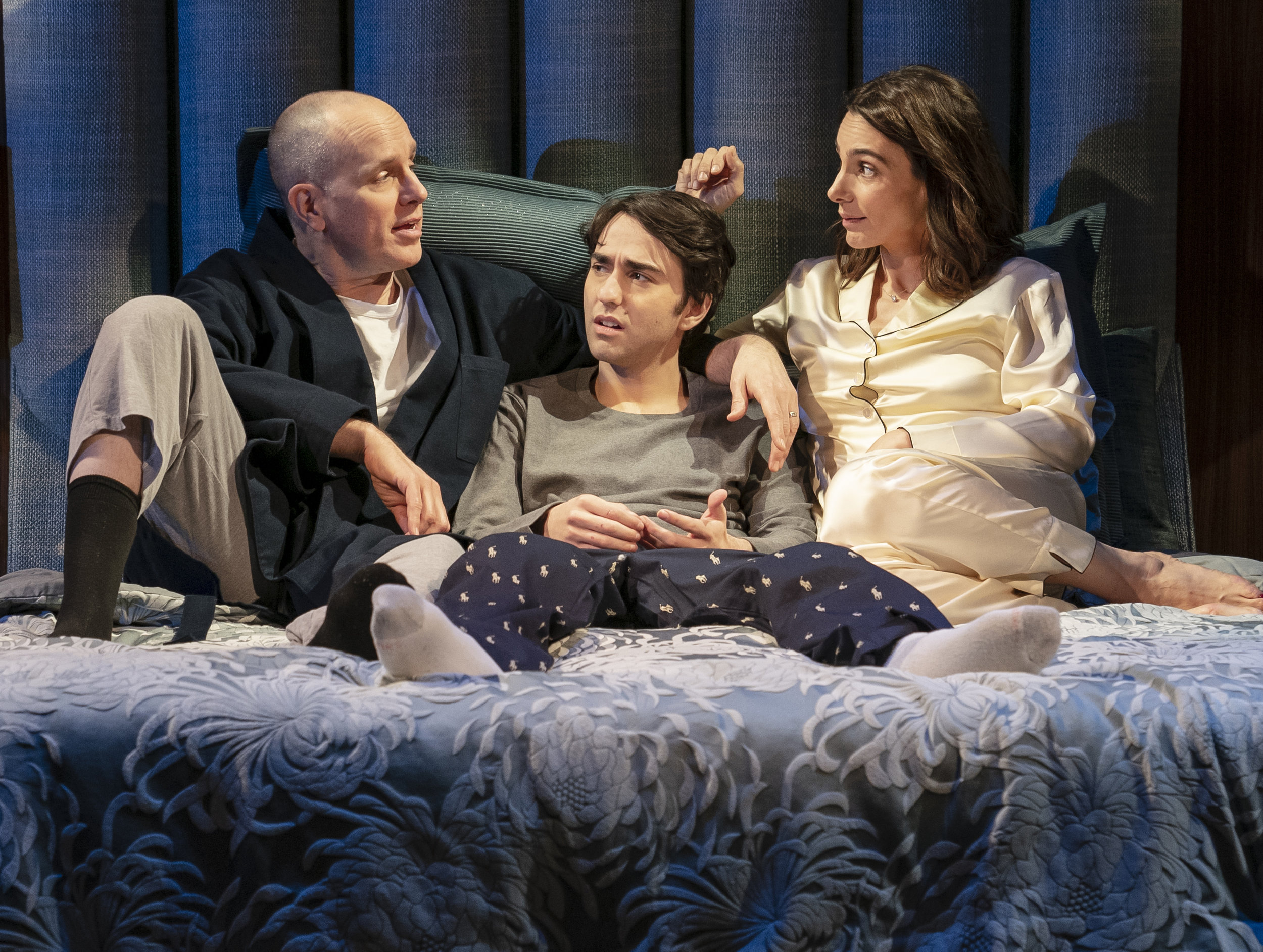 AuCoin, Wolff, and Parisse play a family facing a crisis. Photographs by Joan Marcus.
