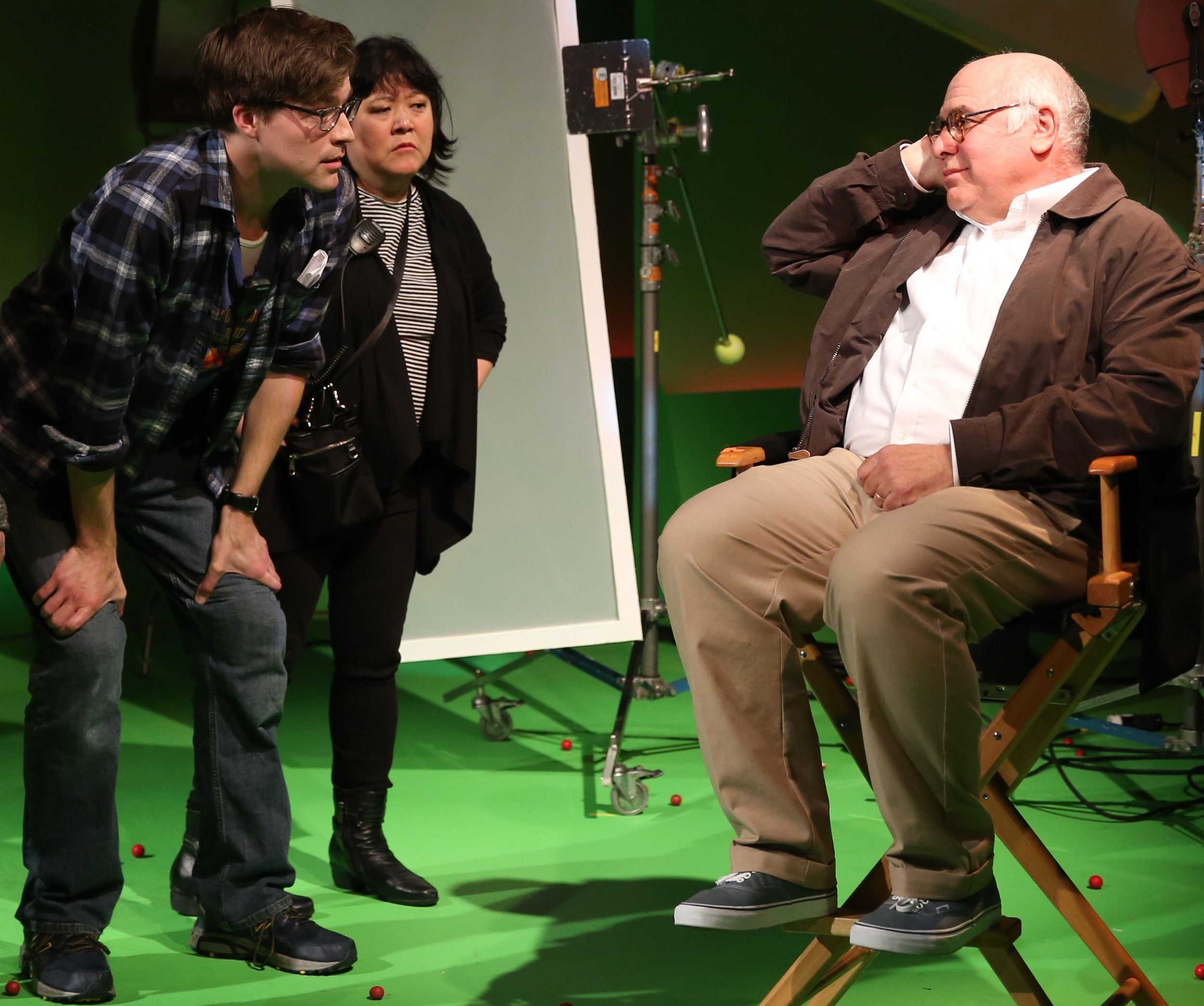 George Hampe (left) plays Rob, a television commercial special-effects assistant, Ann Harada is Alice, the commercial's assistant director, and David Wohl plays director Errol Morris, the Academy Award–winning documentarian, in Rob Ackerman's workplace comedy,  Dropping Gumballs on Luke Wilson .