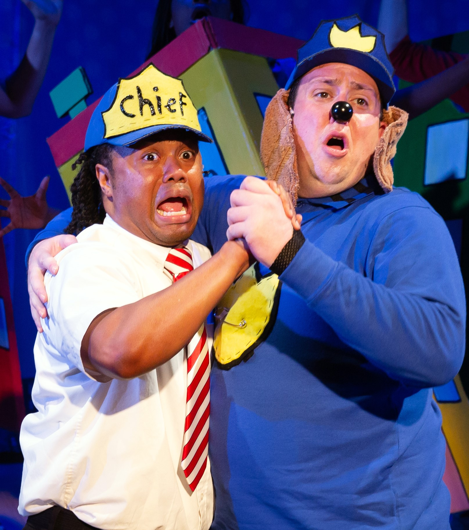 Dan Rosales (left) plays the Police Chief, and Brian Owen is Dog Man in  Dog Man: The Musical,  by Kevin Del Aguila and Brad Alexander.