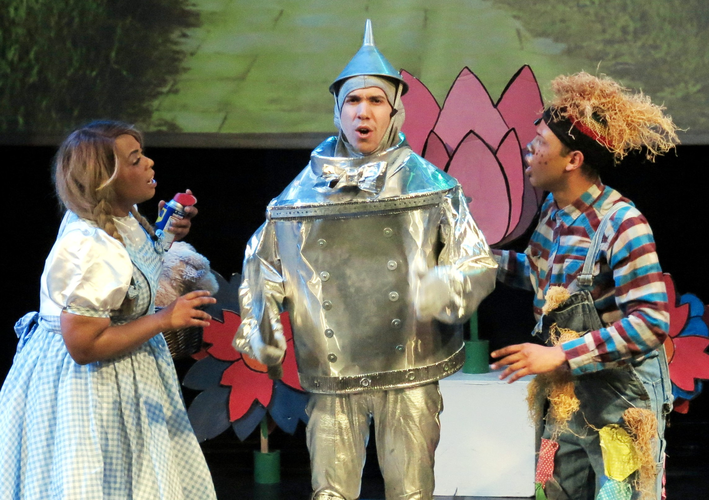 From left: Taylor-Rey Rivera as Dorothy, Ben Harburg as Tin-Man, and Derrick Montalvo as Scarecrow. Photograph by Jonathan Slaff. Banner photo by Rina Kopalla