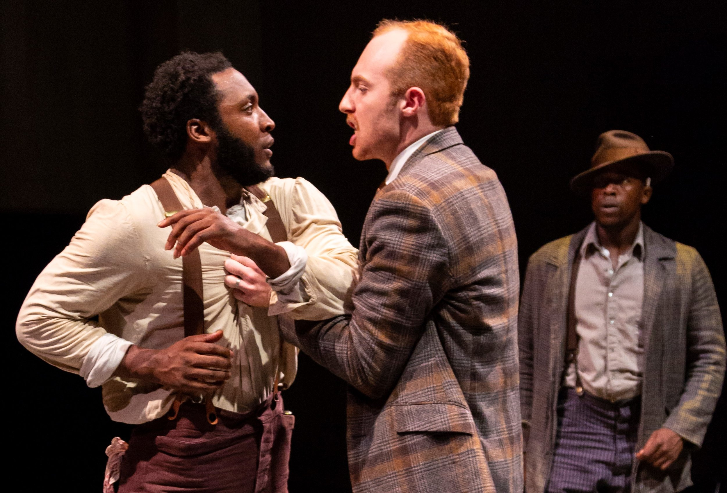 Galen Ryan Kane (left) is Bigger Thomas, and Henry Jenkinson is Mr. Britten, a private investigator looking into a socialite's disappearance, in  Native Son.  Jason Bowen (right) as Bigger's alter ego, the Black Rat, stands by helplessly.