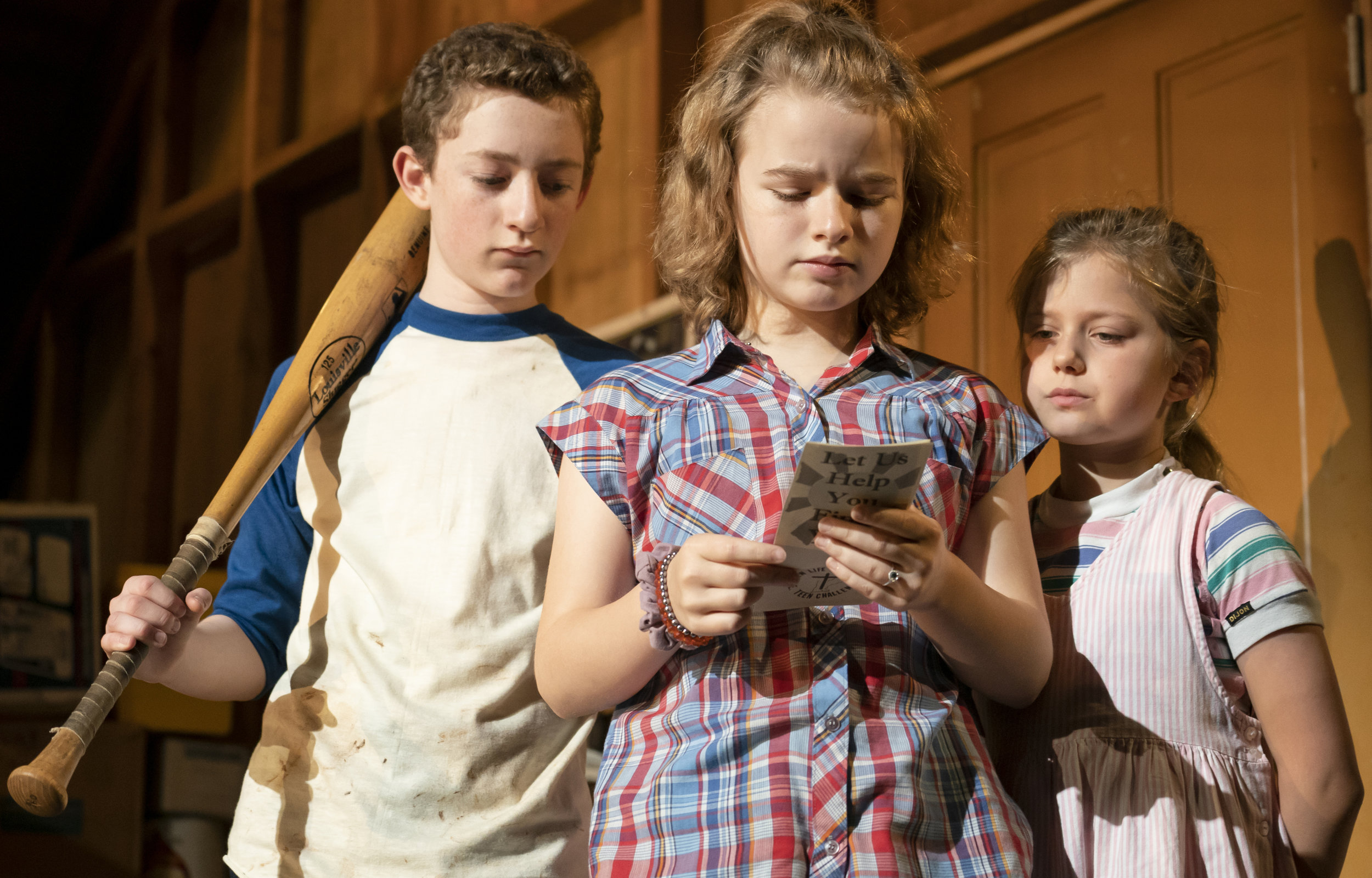 Ryan Foust as Young Chris, Maren Heary as Young Kate, and Casey Hilton as Young Addie confront their first major crisis in the Second Stage production of Bess Wohl's  Make Believe.