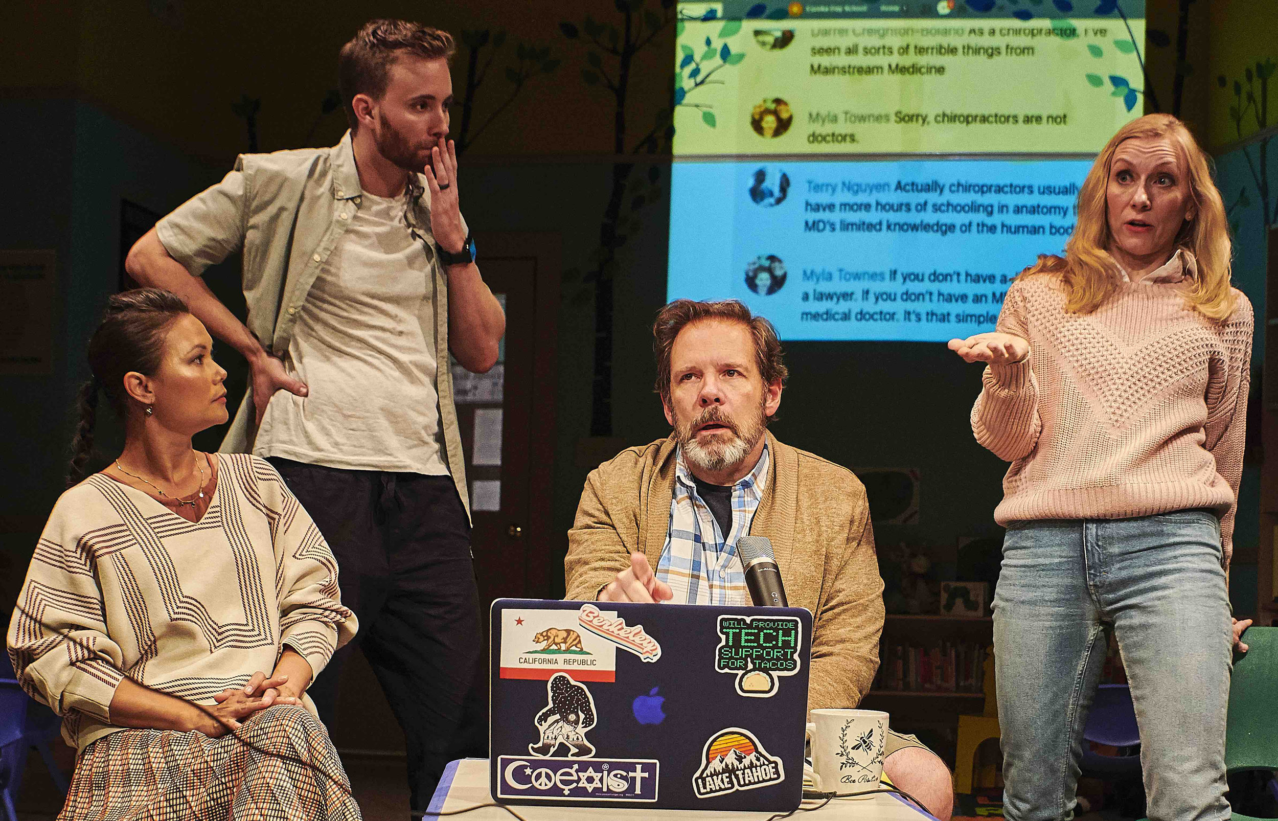 From left, K.K. Moggie as Meiko, Brian Wiles as Eli, Thomas Jay Ryan as Don, and Tina Benko as Suzanne grapple with anti-vaxxing issues in Jonathan Spector's satire  Eureka Day.