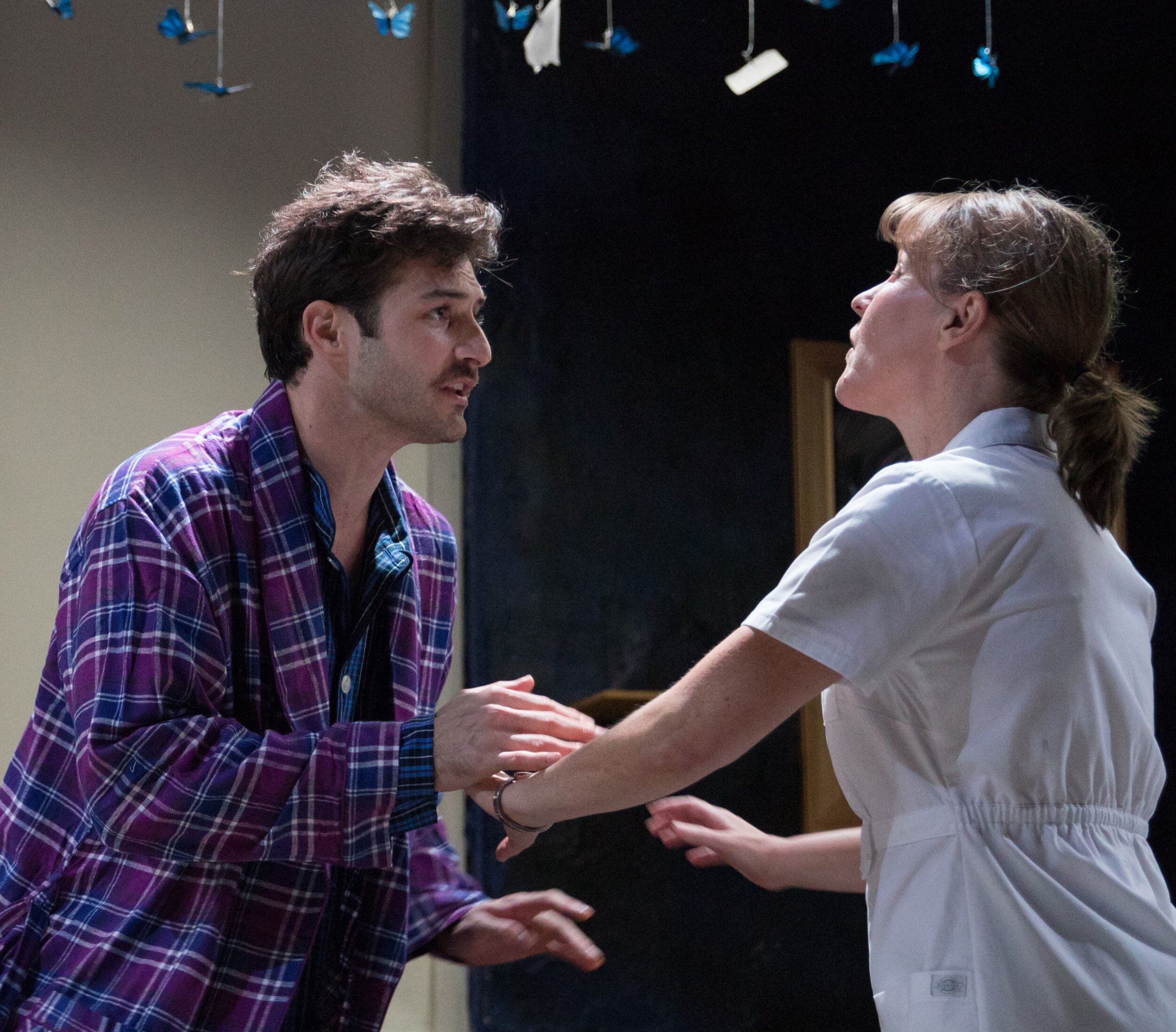 JB (Justin Genna) outlines his dreams of future dances to Nurse No. 1 (Kelly McAndrew) while succumbing to AIDS.