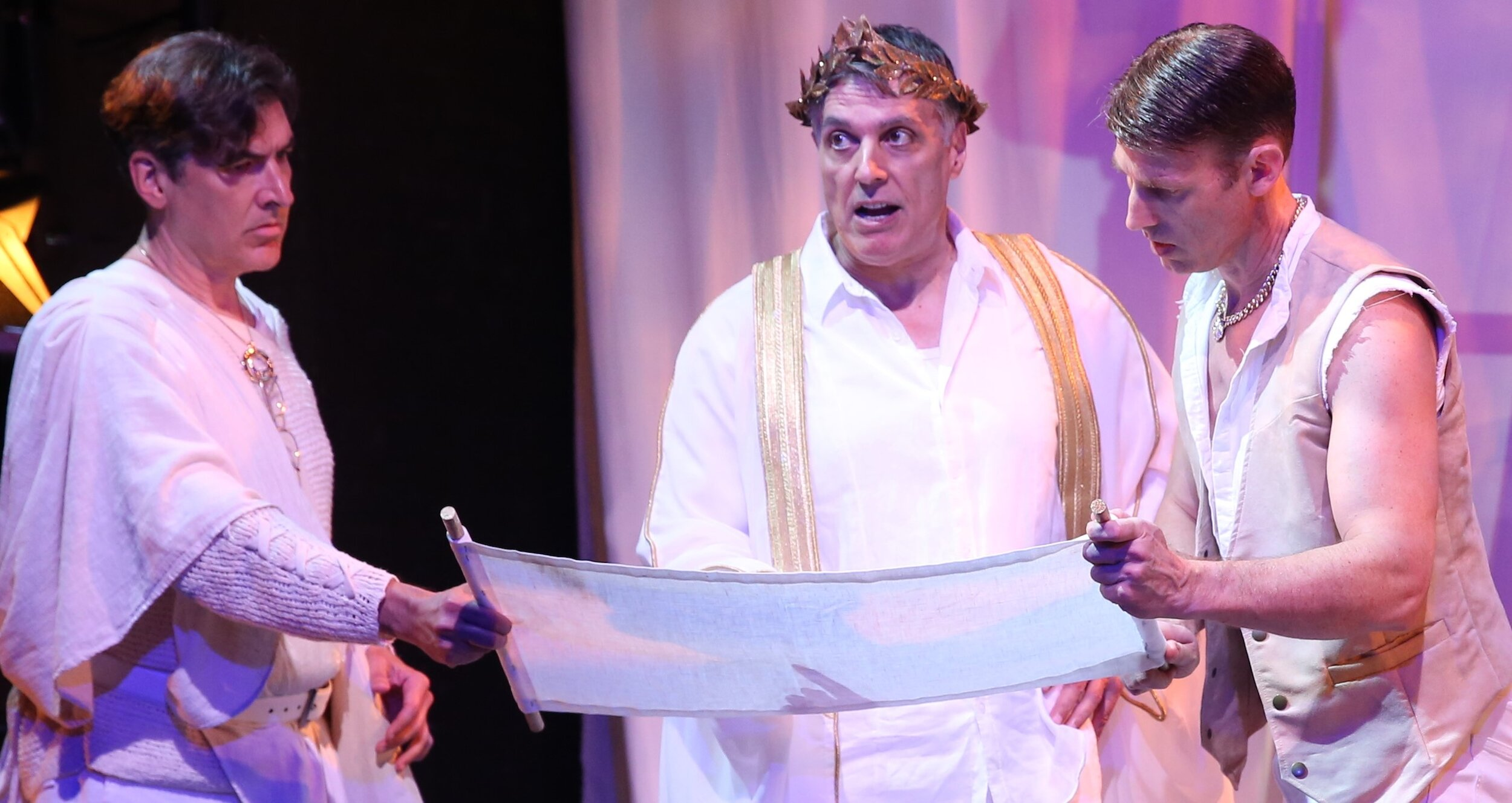 Caesar with his secretary Britannus (Jonathan Hadley, left) and Rufio (Jeff Applegate), his right-hand man.