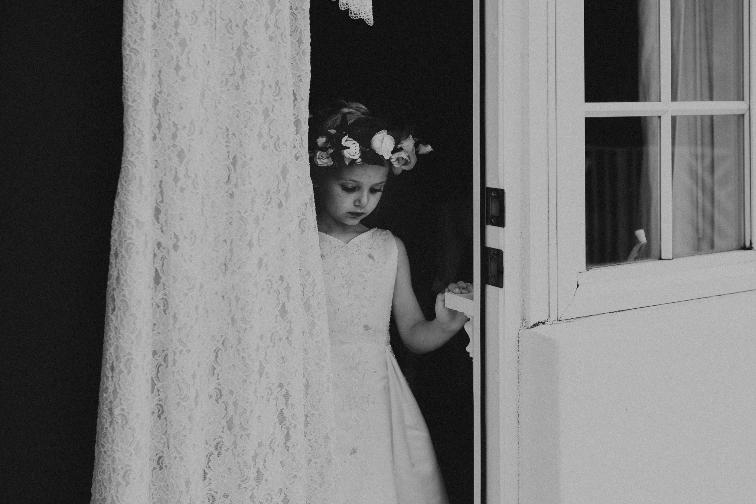 flower girl with moms wedding dress