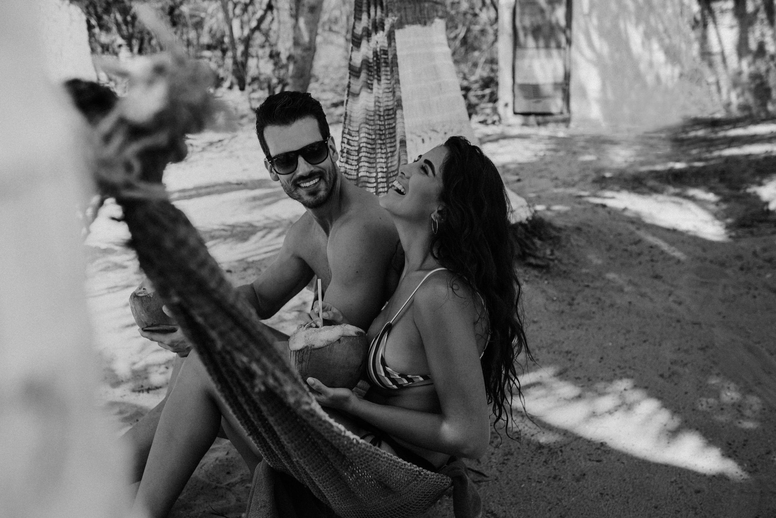 couple in a hammock in tulum mexico