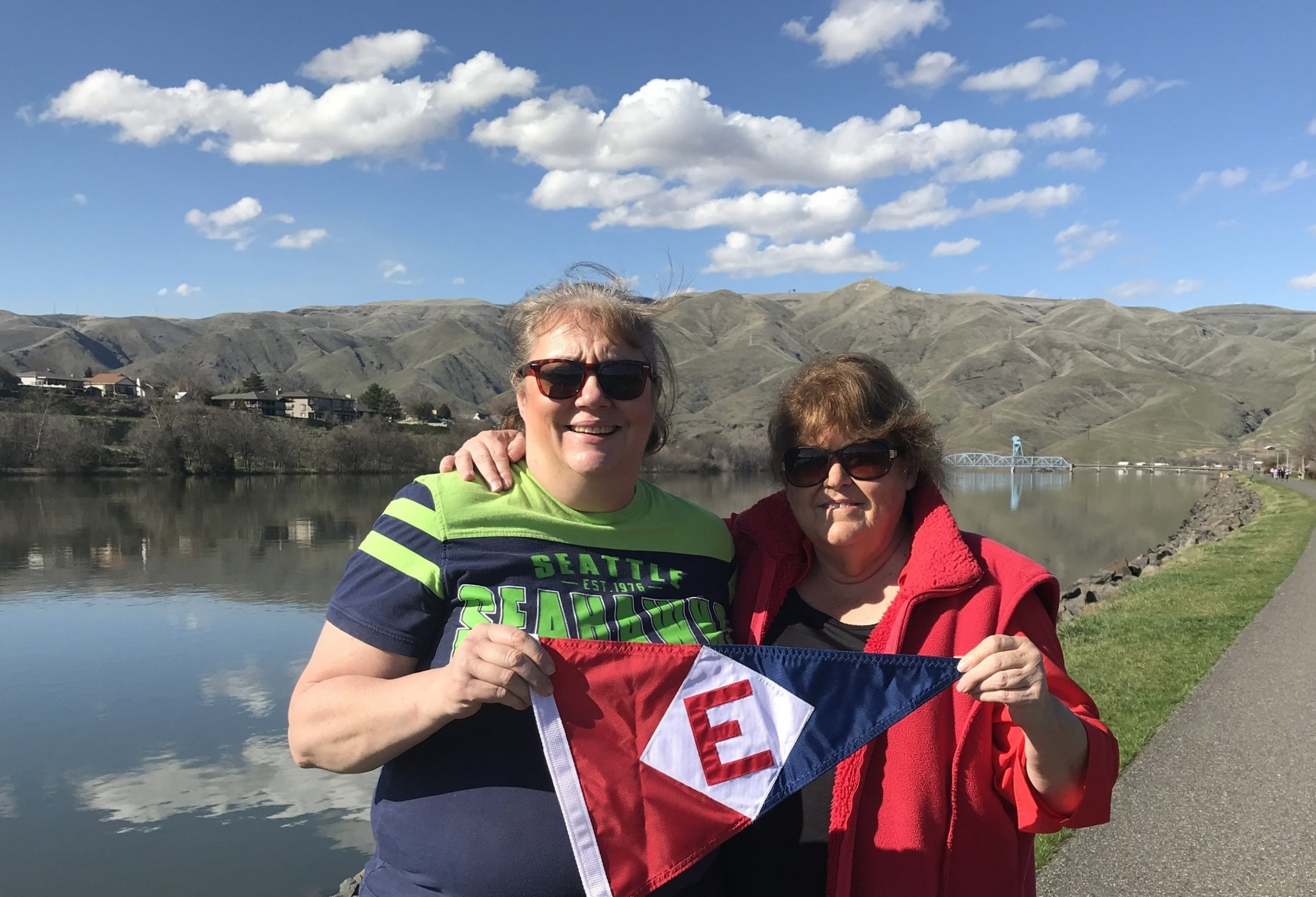 Janet Mitchell and Leta Sellers share their EYC pride at the Snake River in Idaho.