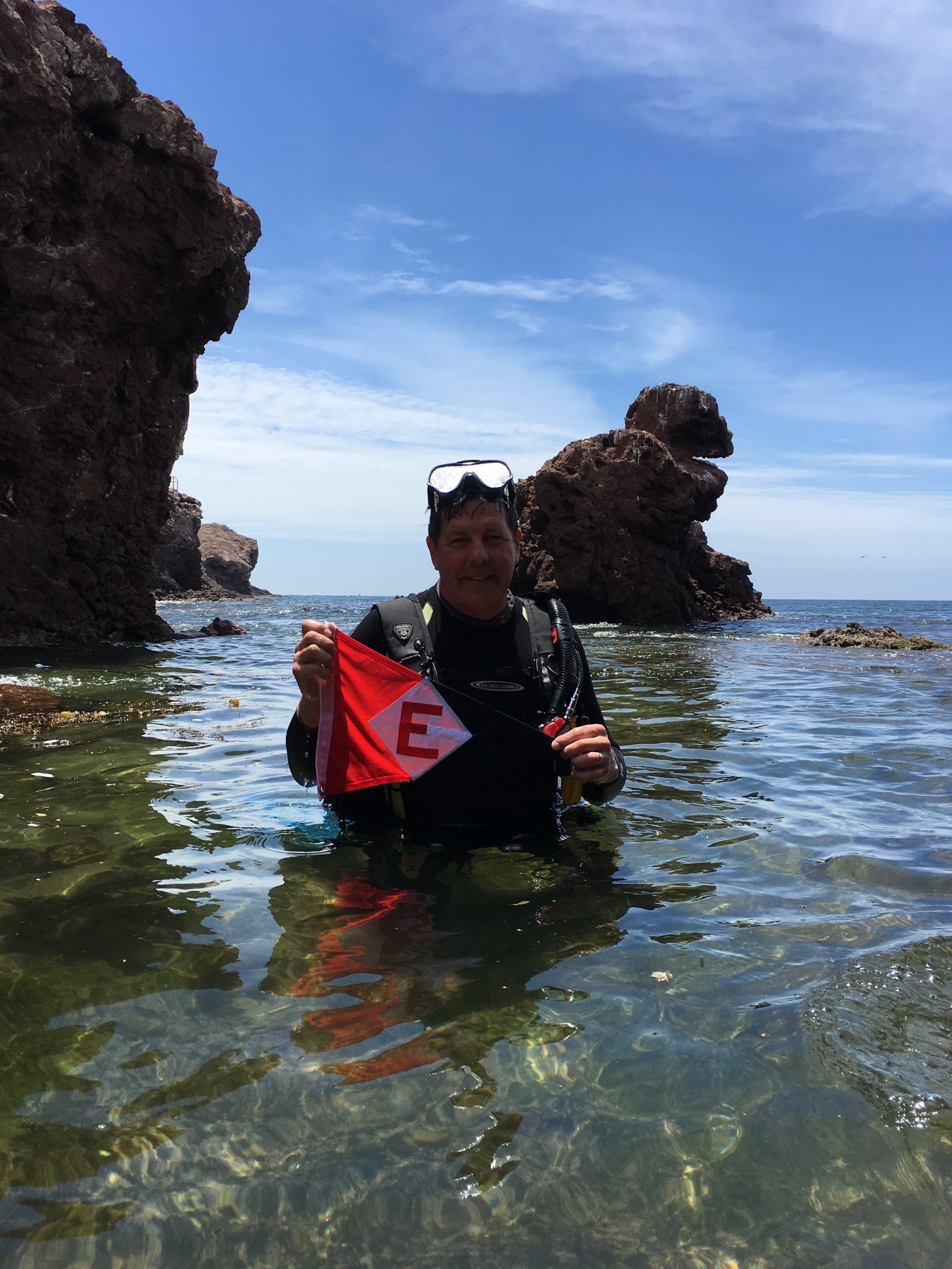On a diving trip to the Sea of Cortez, Rob Moline takes a moment to show his EYC pride.