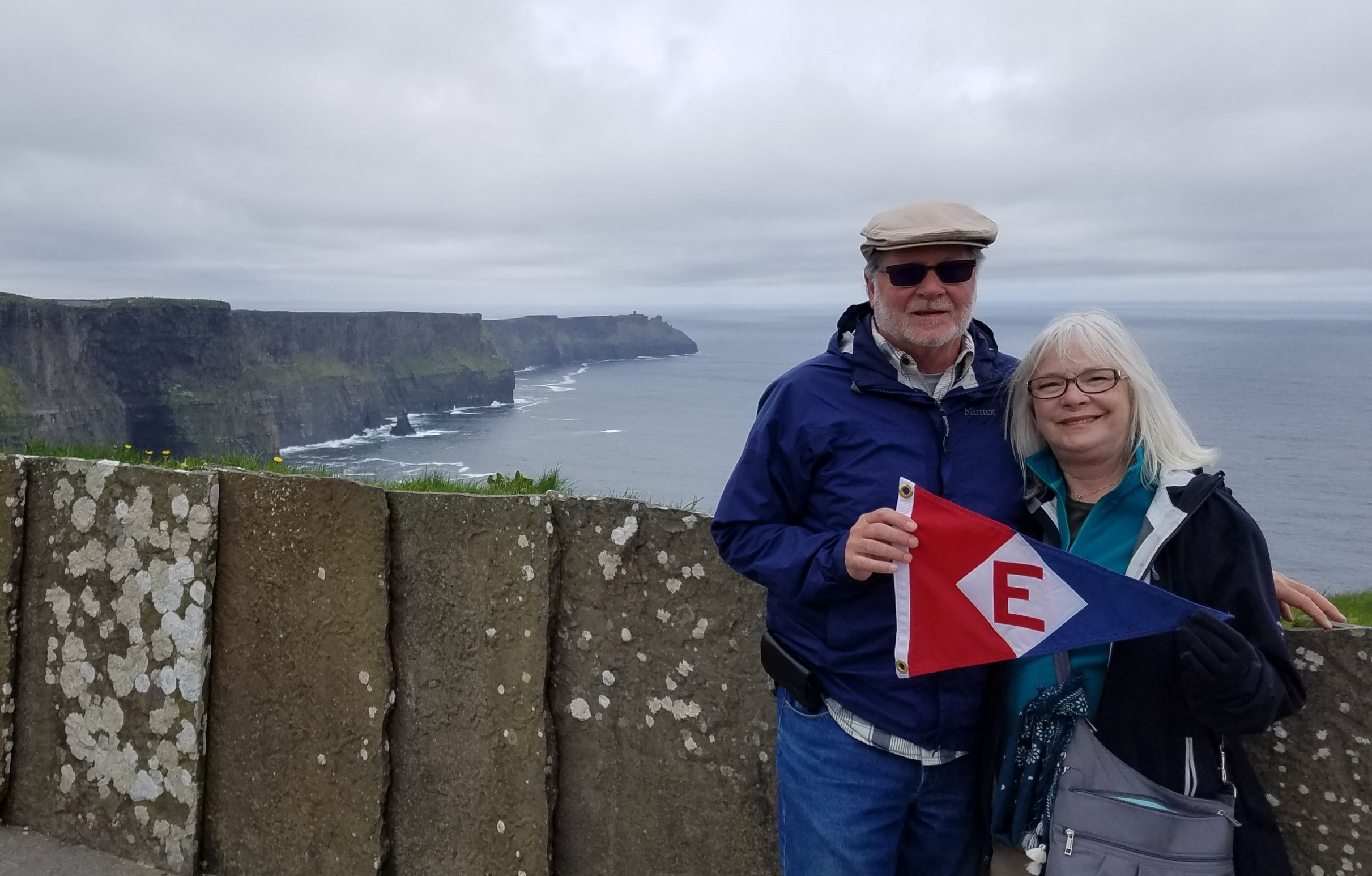 Murray and Linda McLeod fly the EYC burgee from the Cliffs of Moher in Ireland.