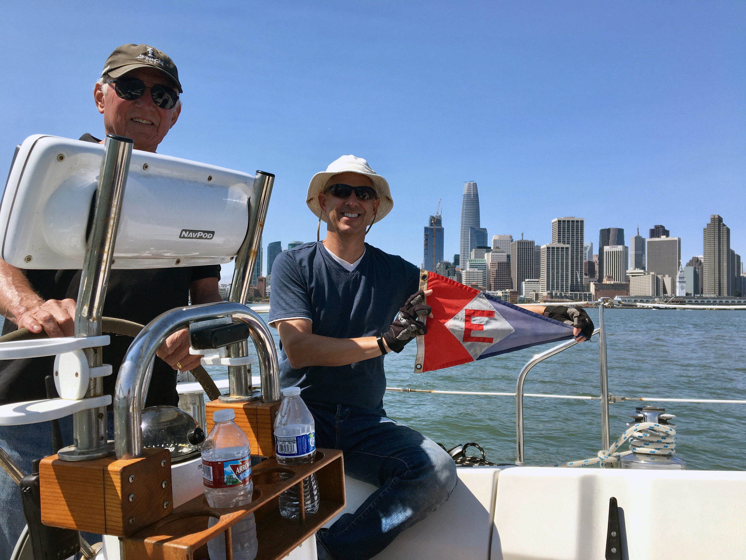 Bob Bollinger at the helm with son Bob on San Francisco Bay