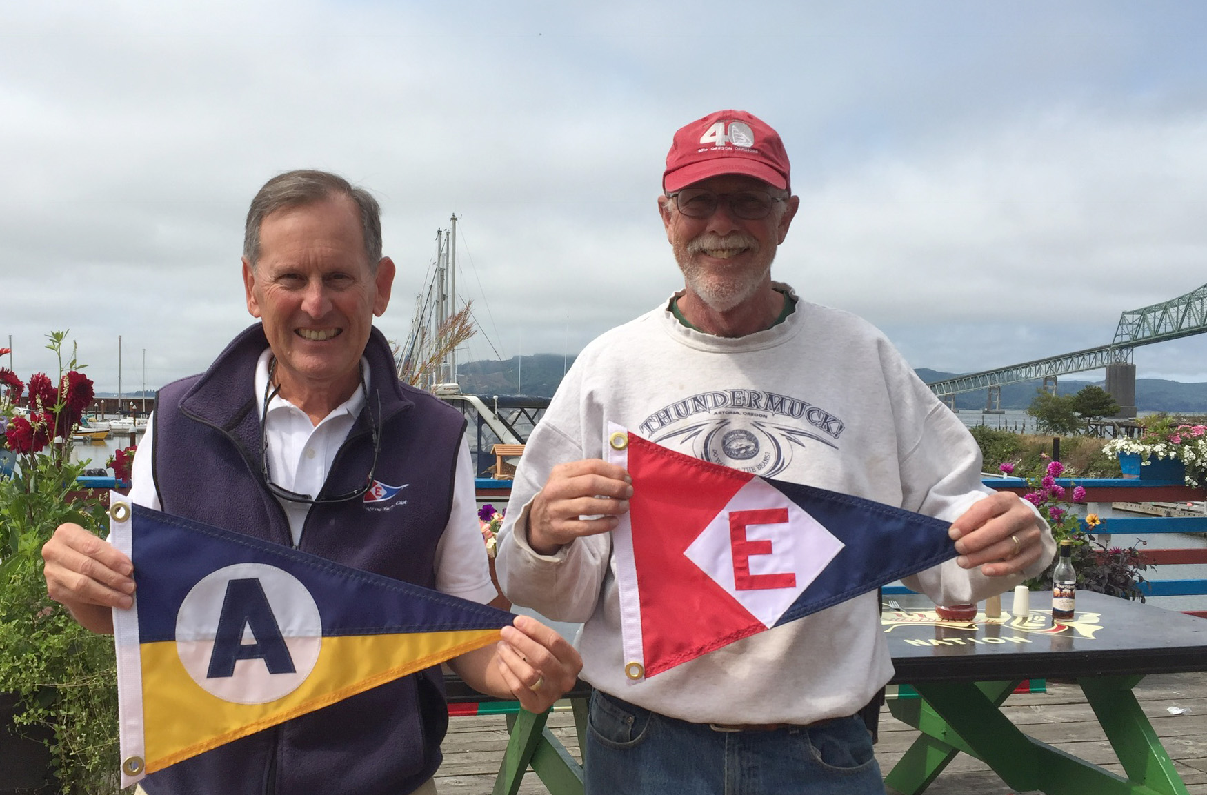 A burgee exchange between commodores of EYC and Astoria Yacht Club