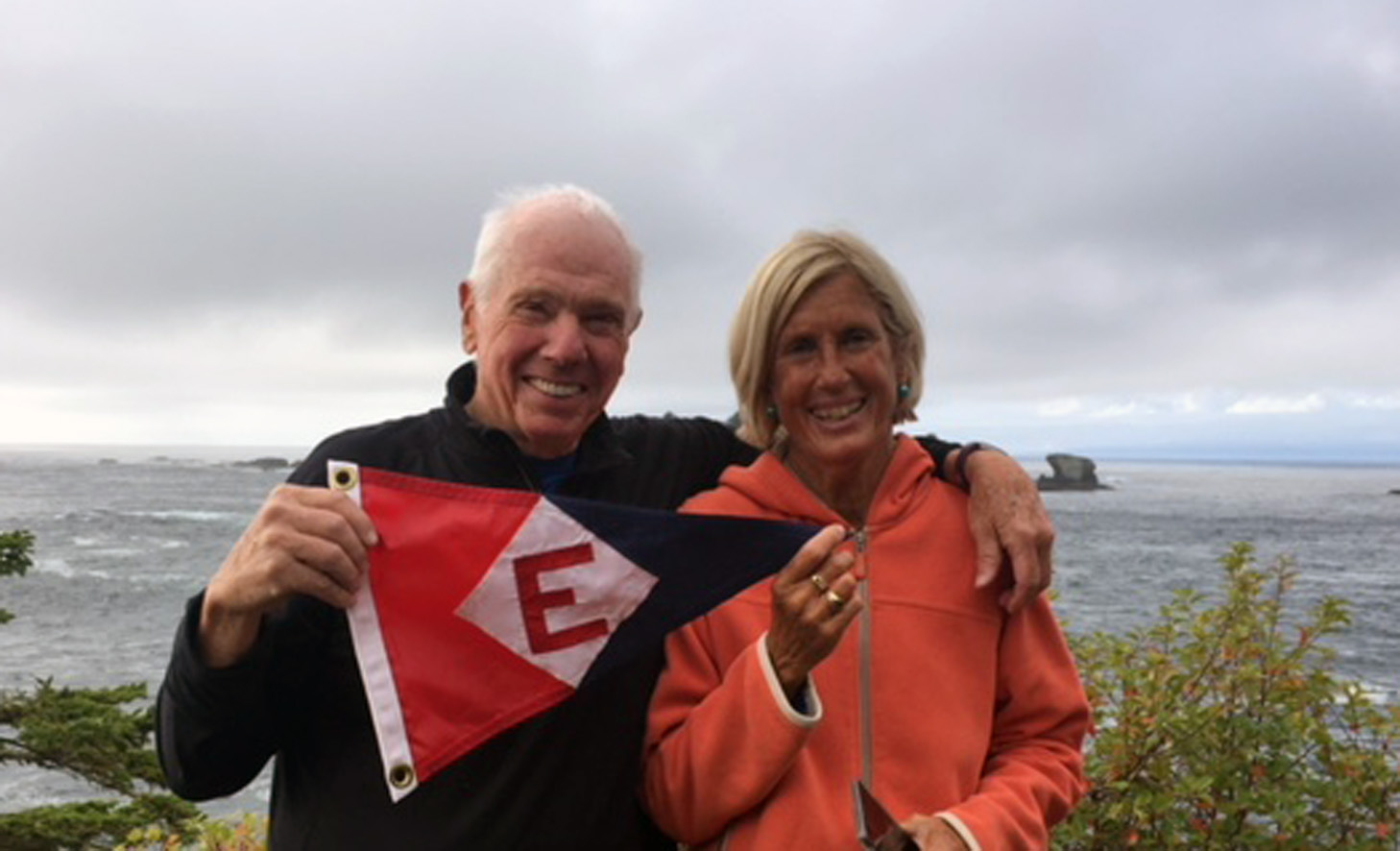 Bill and Nadine Powell show their pride at Cape Flattery, WA—the northwesternmost point of land in the continental United States