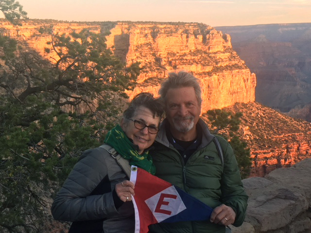 Sheena and Mark Schroeder—and their burgee—greet the sunrise at the Grand Canyon