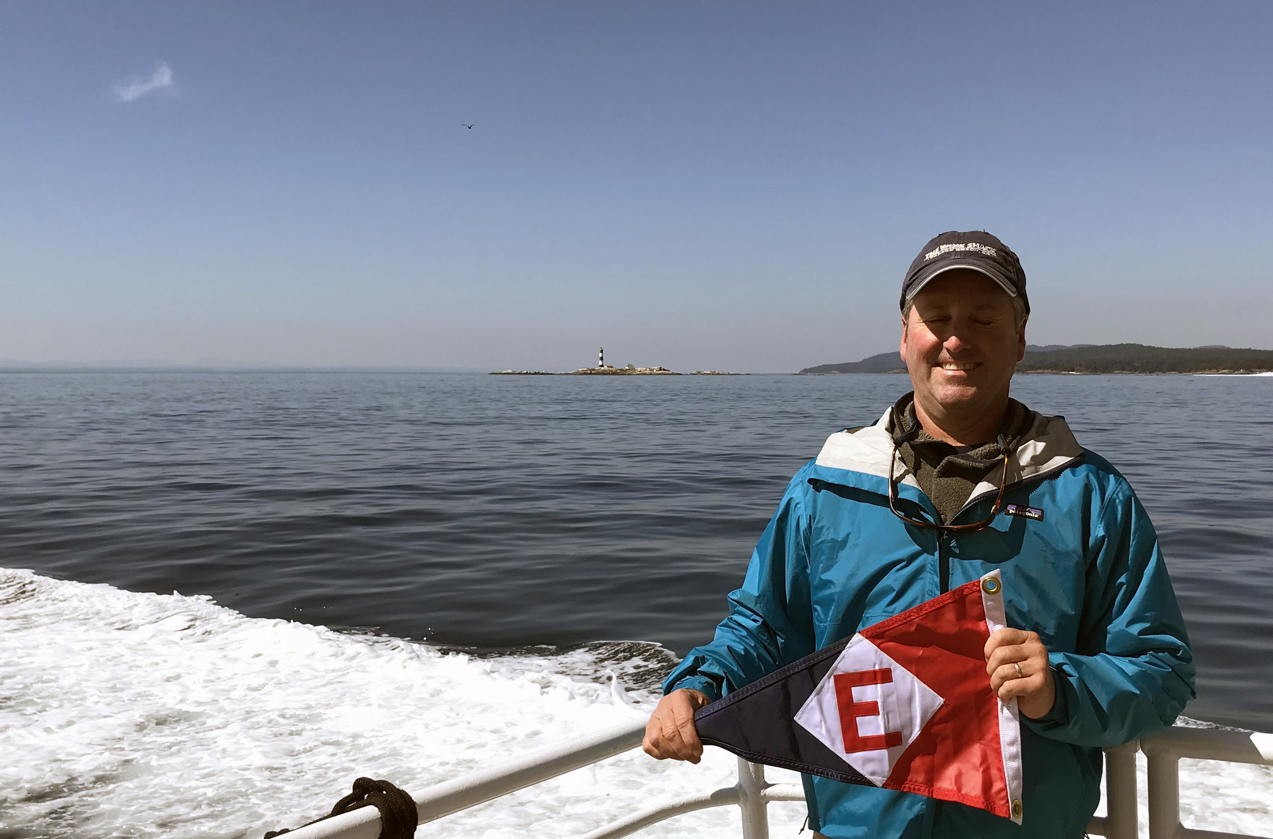 Jonathan Oberlander takes his burgee for a ride in the harbor in Victoria, BC