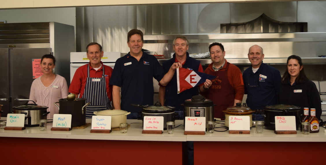 The 2019 Board of Trustees shows their colors and shares their recipes at the Annual Chili Feed