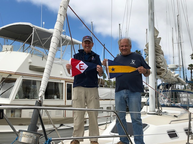 Rear Commodore Gary Powell exchanges burgees with the Navy Yacht Club in Long Beach, CA