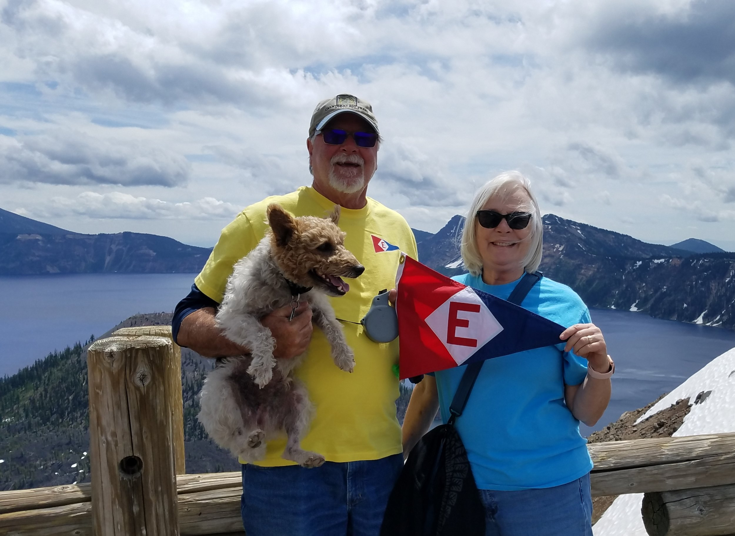 Murray & Linda McLeod hoist the colors—and their pooch—at Crater Lake