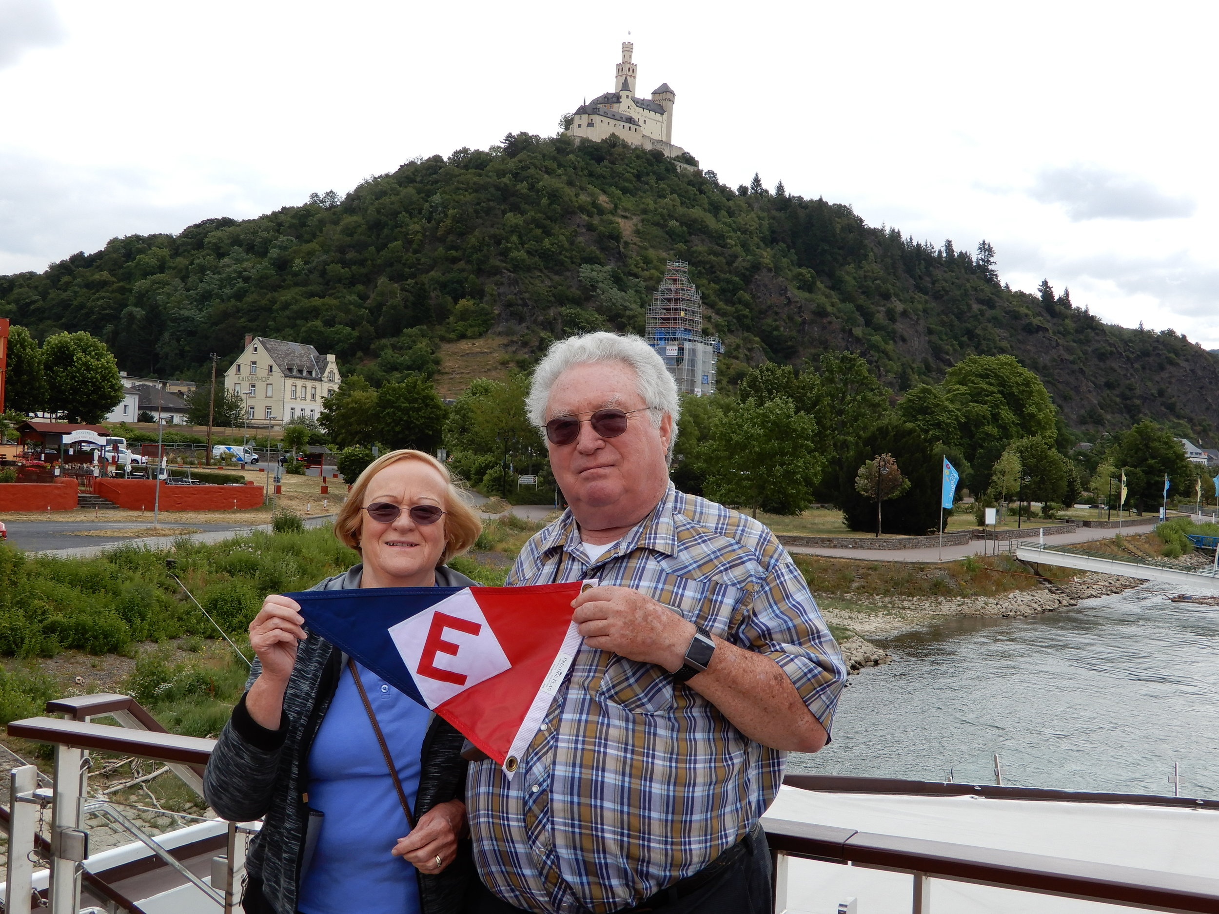 Joan and Keith show their EYC pride in the shadow of the Marksburg Castle on the Rhine River in Germany