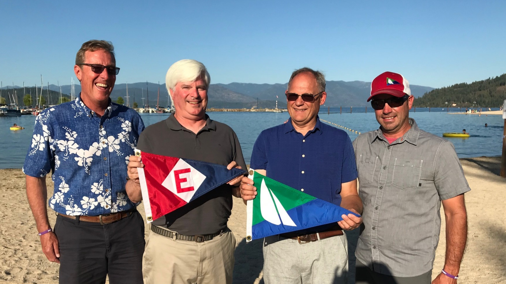 Club Manager Rich Aaring exchanges burgee with Past, Current and Vice Commodores of Sandpoint Sailing Association in Sandpoint, ID