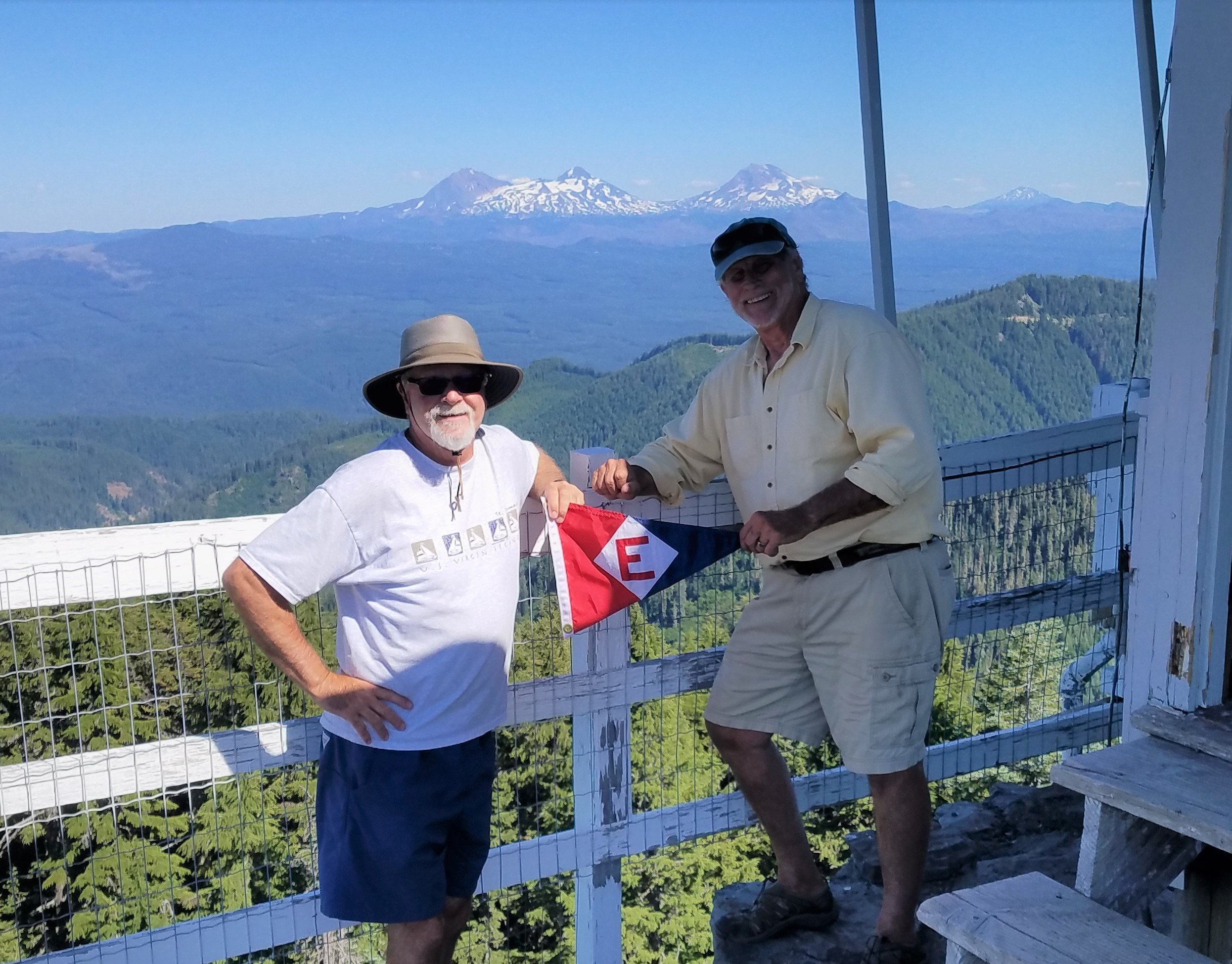Murray and Scott fly the colors from the top of the lookout at Carpenter Mountain in the Cascades.