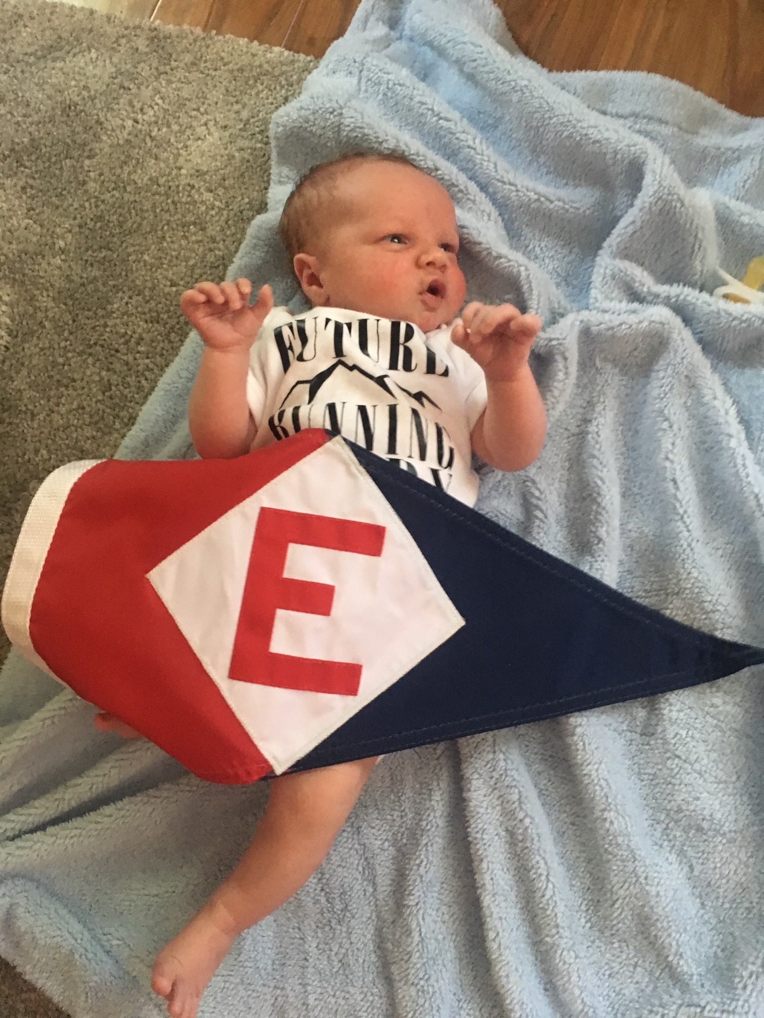 Owen Robert, the newest member of the EYC family, shows his EYC pride
