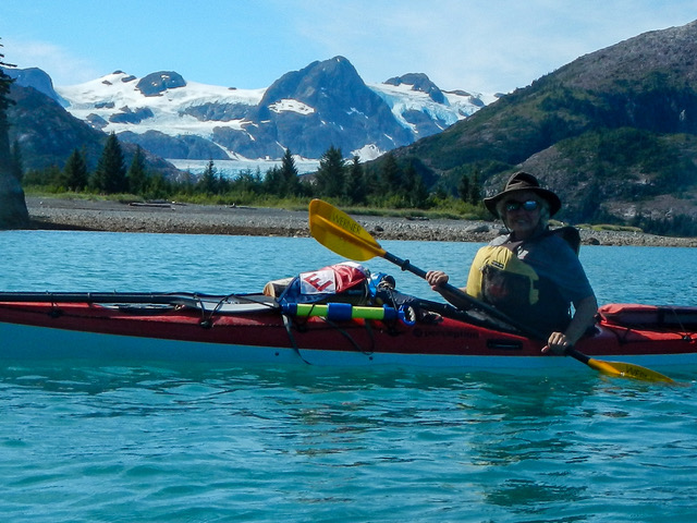 Kay Lee proudly flies her EYC burgee on a sea kayaking trip in Prince William Sound, Alaska
