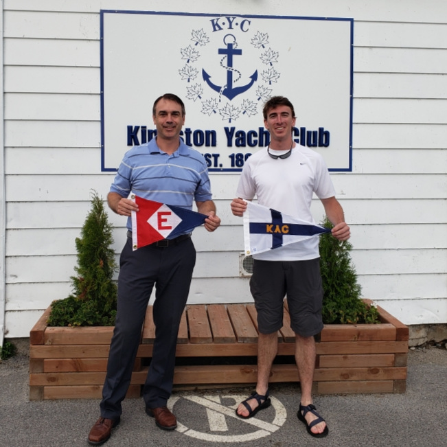 Langdon exchanges burgees with the Commodore of the Kingston Yacht Club in Ontario, Canada