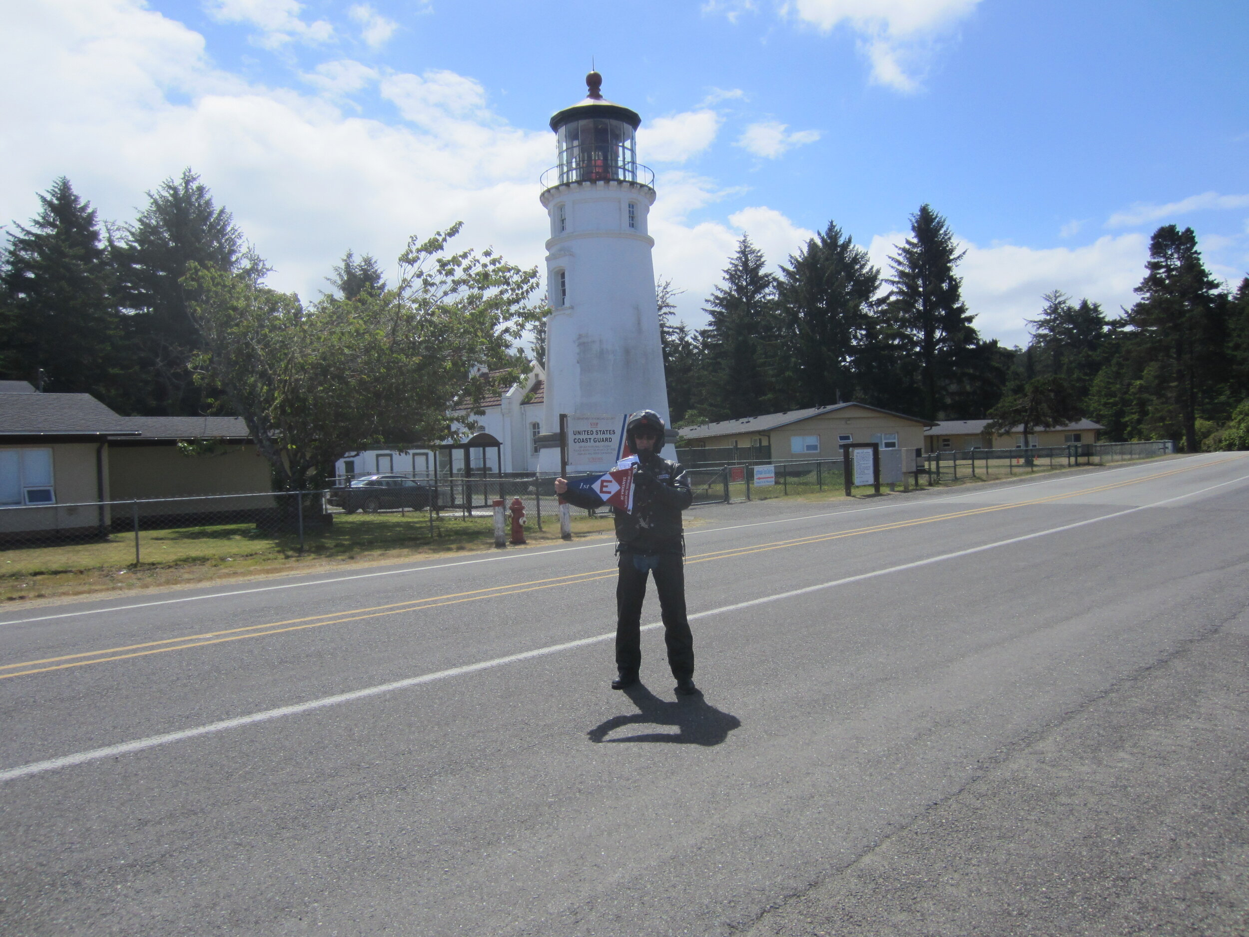 Gordon hoists the EYC colors at the Umpqua Lighthouse in Winchester Bay, Oregon
